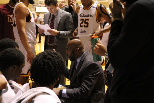Midwestern State's Nelson Haggerty talks to his players during a timeout earlier this season. Haggerty resigned Tuesday after eight seasons as head men's basketball coach.