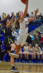 Maysville's Bailee Smith goes up for a layup against Tri-Valley's Laiken Little. The Scotties won 61-55 on Saturday.