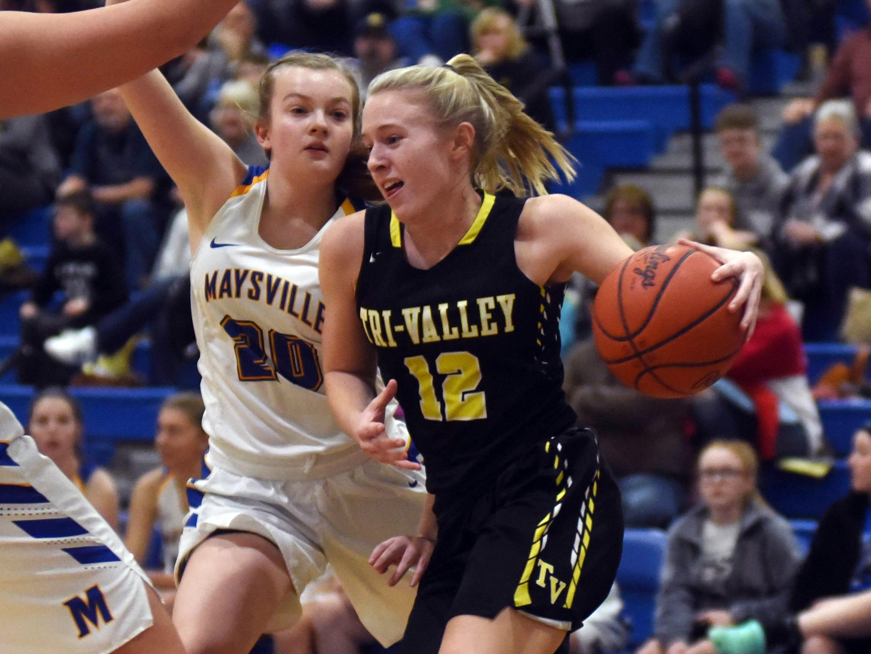 Audrey Spiker, of Tri-Valley, drives the baseline against Maysville's Eden Radde.