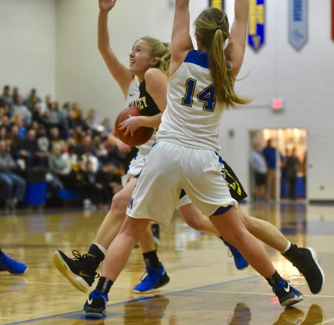 Tri-Valley's Audrey Spiker fights between two Maysville defenders, including Bailee Smith (14), as the Scotties won 61-55 on Saturday.