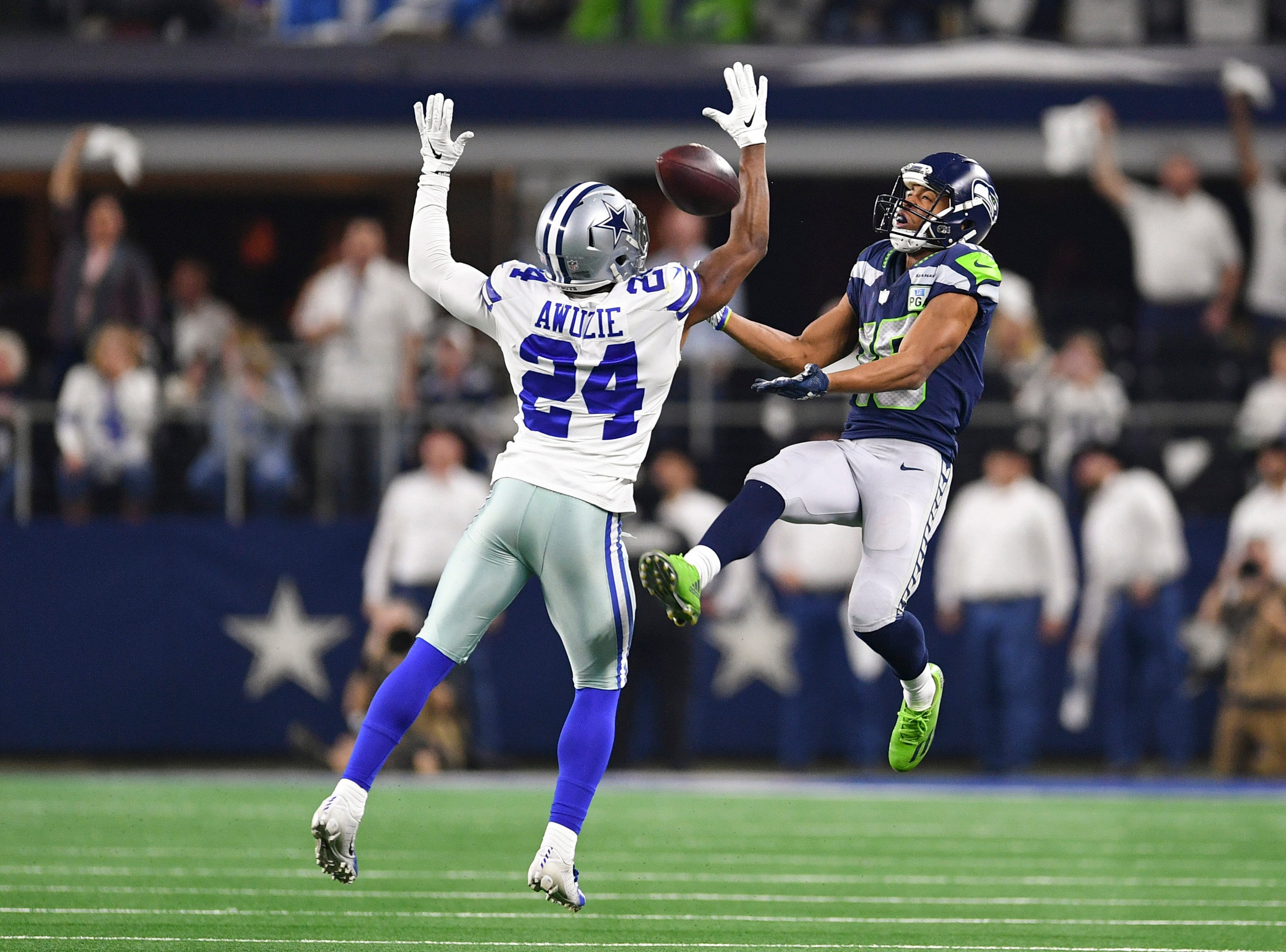 Dallas Cowboys cornerback Chidobe Awuzie (24) breaks up a past intended for Seattle Seahawks wide receiver Tyler Lockett (16) in the second half at AT&T Stadium.