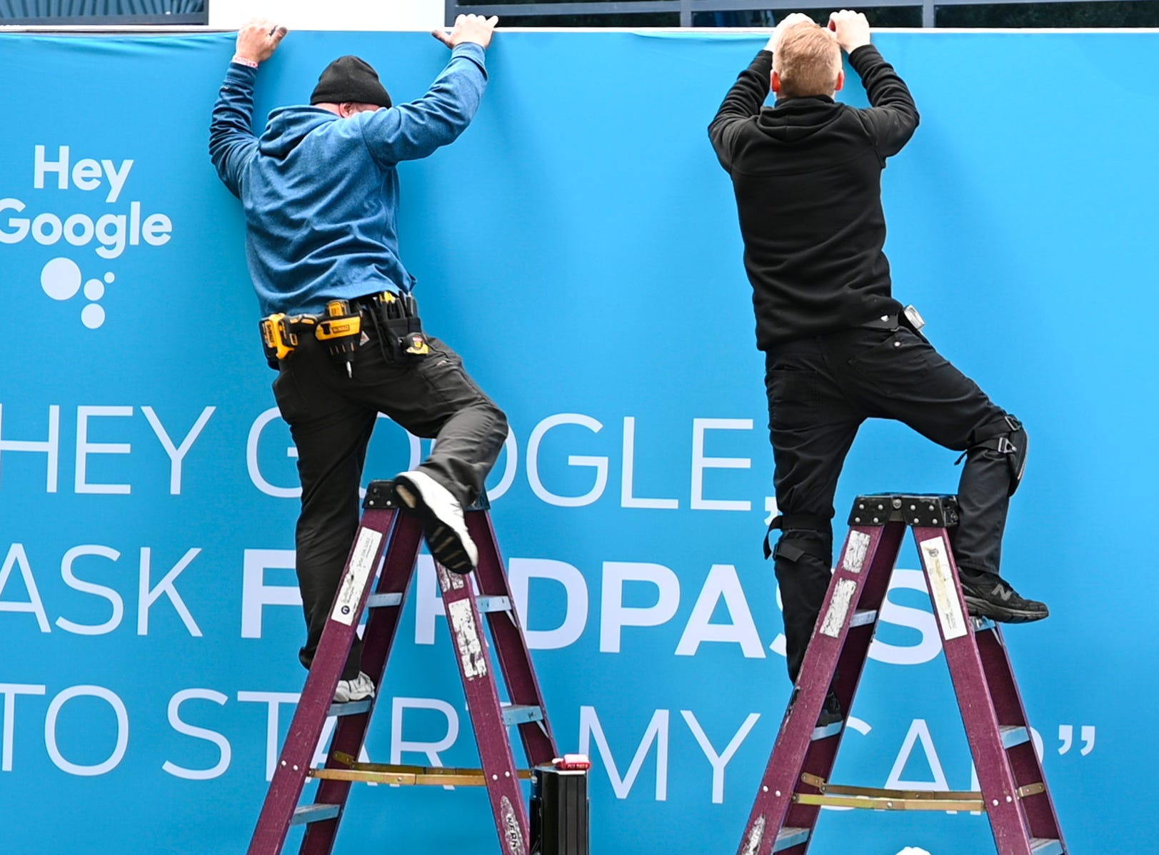 Workers assemble signage for Google outside of the Las Vegas Convention Center. The Consumer Electronics Show 2019 opens on Tuesday, Jan. 8, 2019.