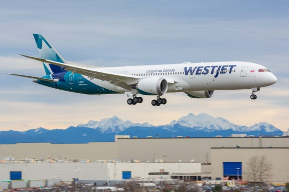 The first Boeing 787 due to Canadian low-cost airline WestJet lands at Boeing's factory in Everett, Washington, after its first flight on Jan. 5, 2019.