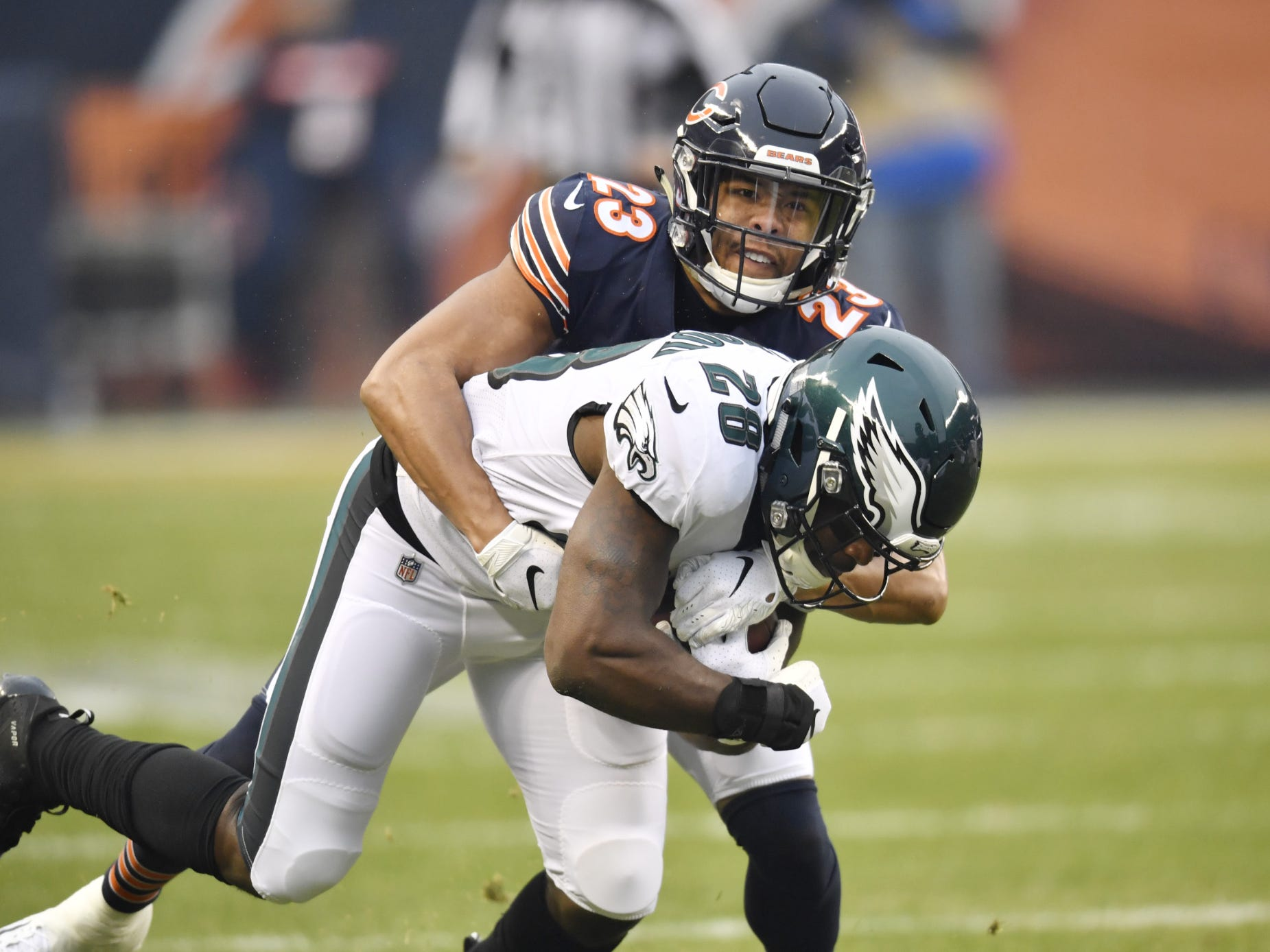 Philadelphia Eagles running back Wendell Smallwood (28) is tackled by Chicago Bears cornerback Kyle Fuller (23) in the first quarter a NFC Wild Card playoff football game at Soldier Field.