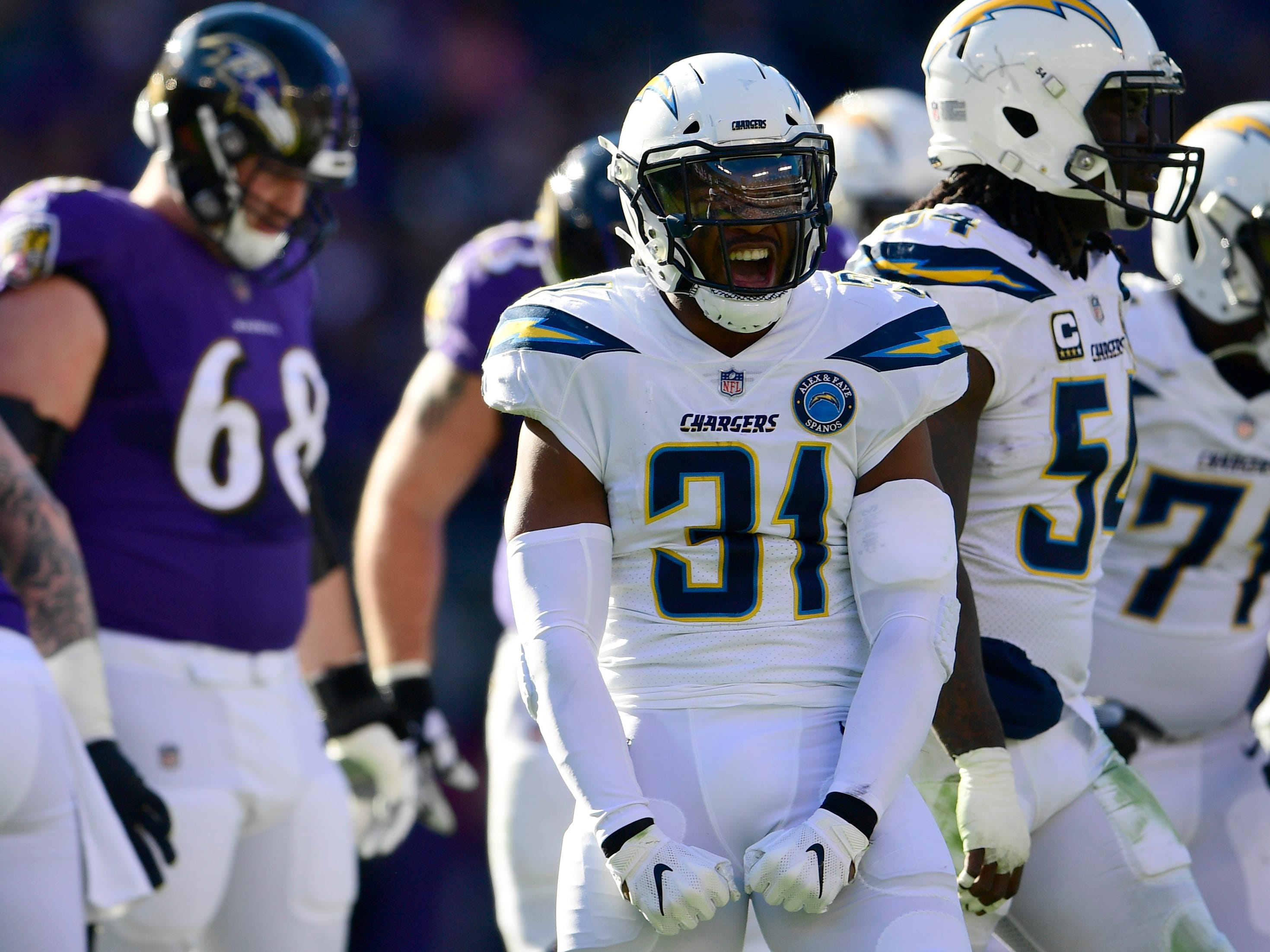 Jan 6, 2019; Baltimore, MD, USA; Los Angeles Chargers safety Adrian Phillips (31) reacts after tackling Baltimore Ravens running back Kenneth Dixon (not pictured) during the first quarter in a AFC Wild Card playoff football game at M&T Bank Stadium. Mandatory Credit: Tommy Gilligan-USA TODAY Sports