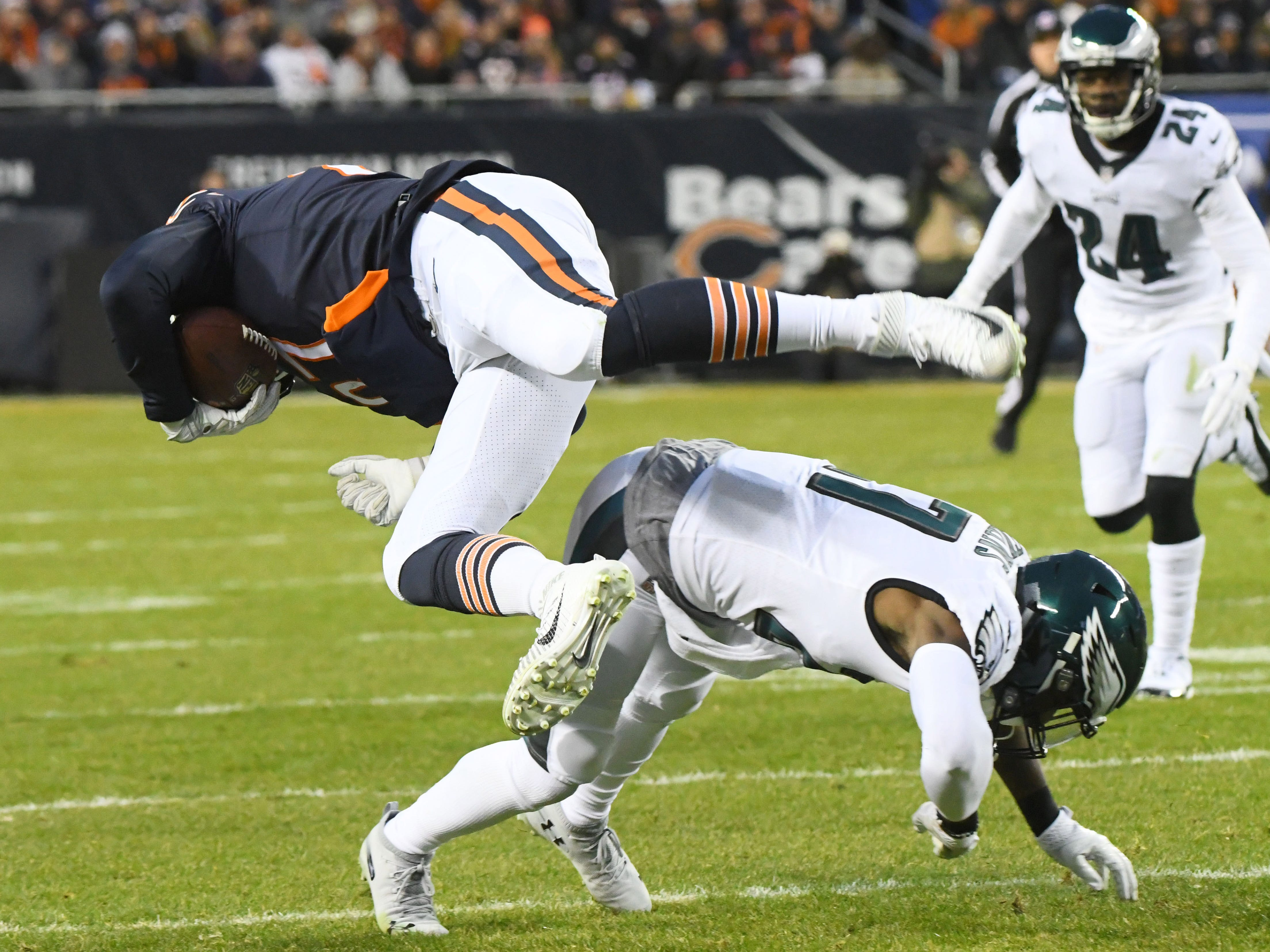 Chicago Bears tight end Adam Shaheen (87) is tackled by Philadelphia Eagles strong safety Malcolm Jenkins (27) in the first half of a NFC Wild Card playoff football game at Soldier Field.