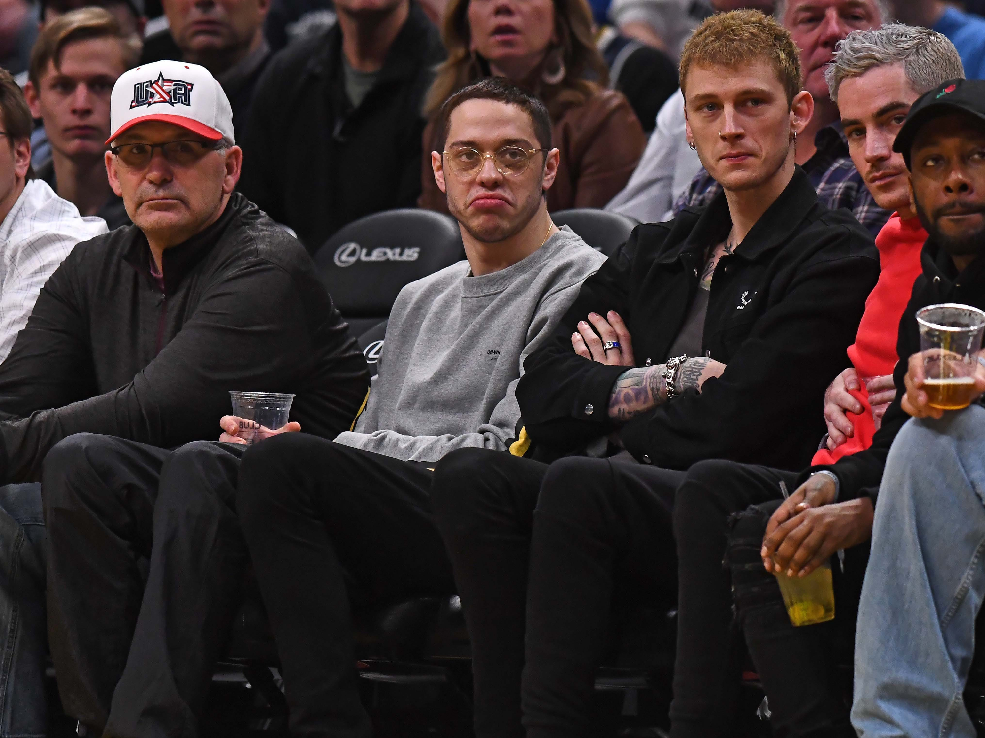 Jan. 5: Pete Davidson and Machine Gun Kelly take in the Nuggets-Hornets game in Denver.