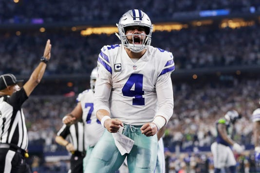 0486272ff50 Nfl Nfc Wild Card Seattle Seahawks At Dallas Cowboys. Dallas Cowboys  quarterback Dak Prescott ...