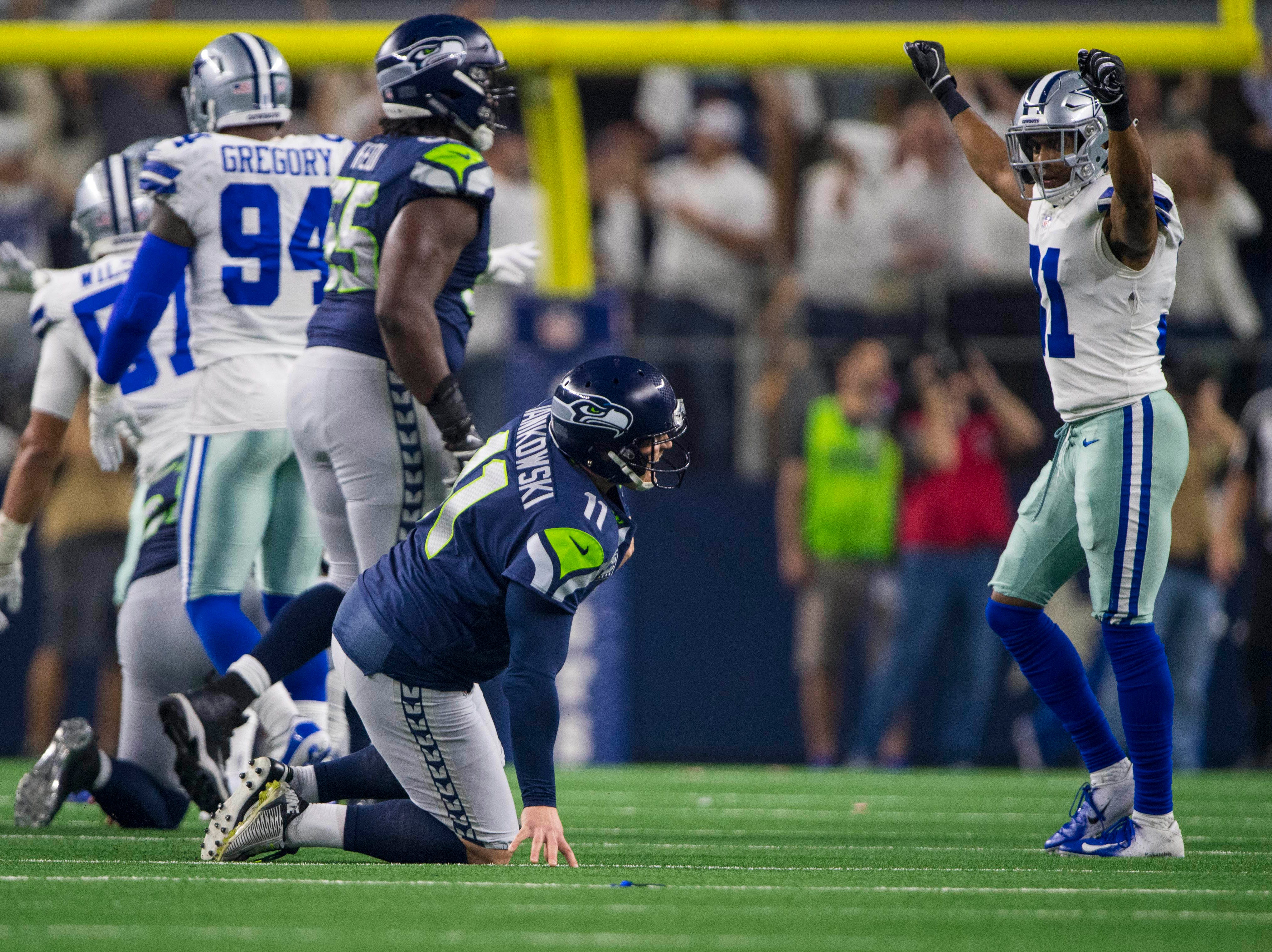 Seattle Seahawks kicker Sebastian Janikowski (11) reacts after suffering an apparent injury while attempting to kick a field goal against the Dallas Cowboys at the end of the second quarter at AT&T Stadium.