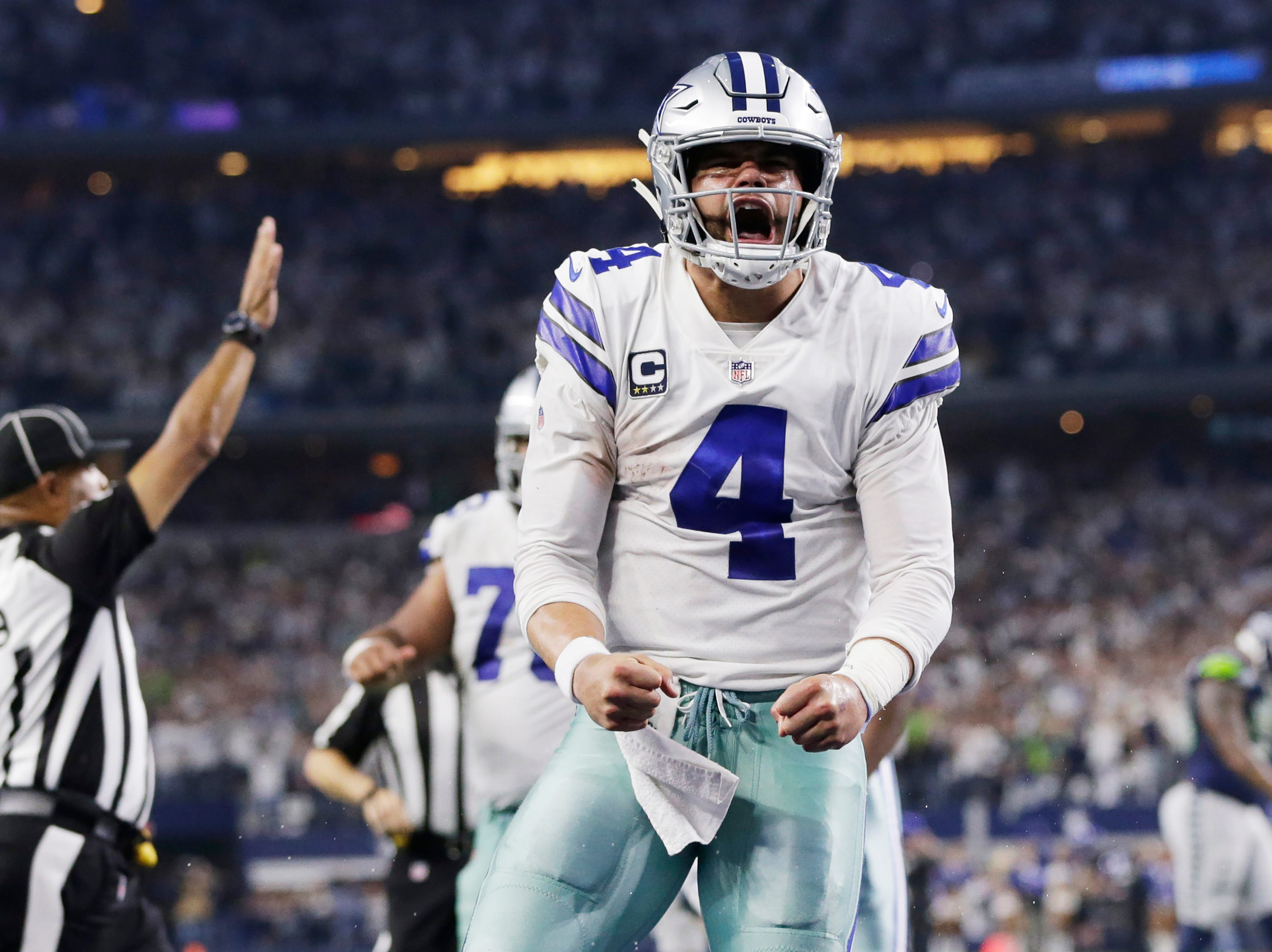 Dallas Cowboys quarterback Dak Prescott (4) reacts to running to the 1-yard line in the fourth quarter against the Seattle Seahawks at AT&T Stadium. Prescott would punch it in himself as the Cowboys went on to a 24-22 win.
