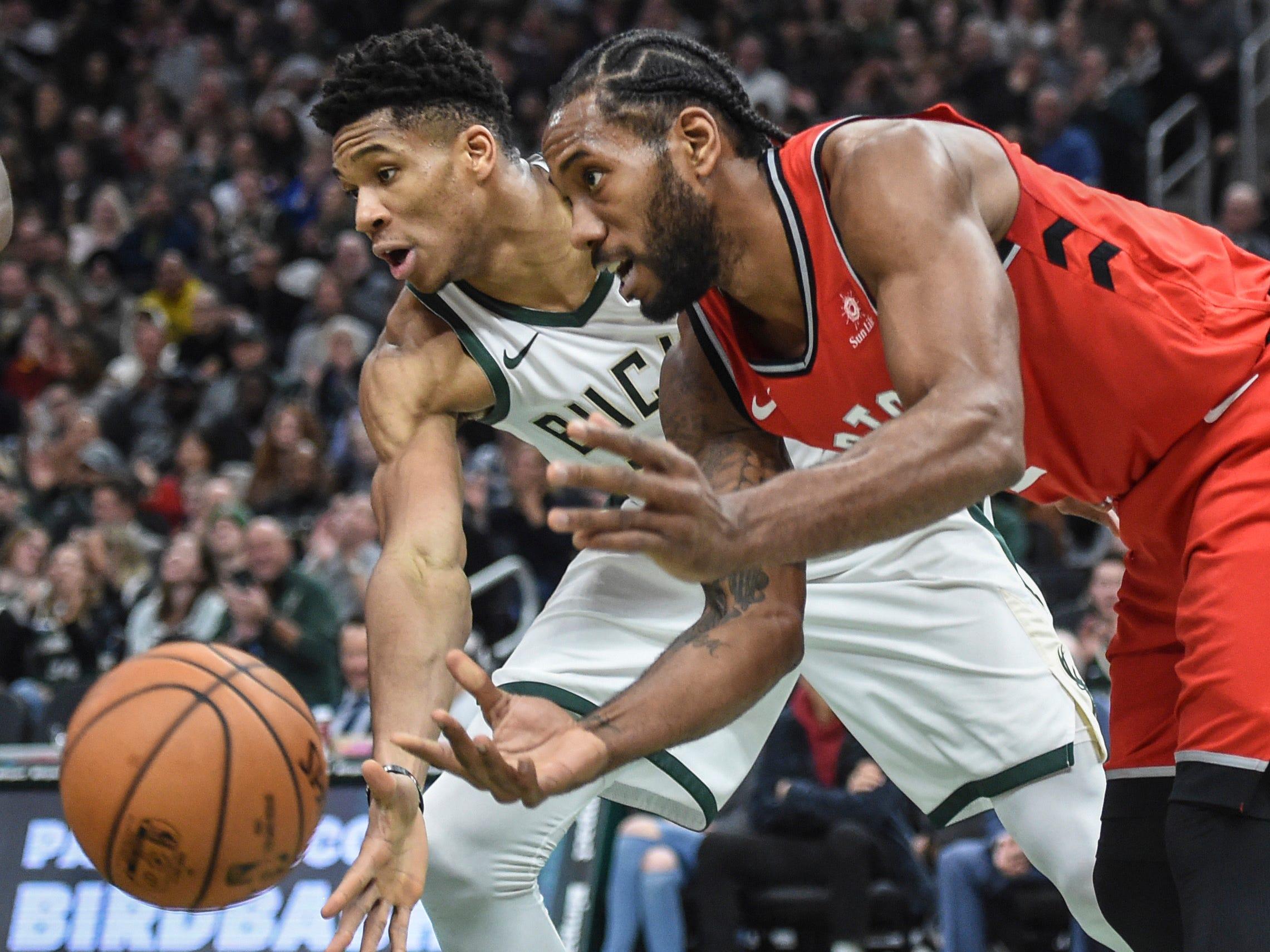 Jan. 5: Bucks defender Giannis Antetokounmpo, left, knocks the ball away from Raptors forward Kawhi Leonard during the second quarter in Milwaukee.