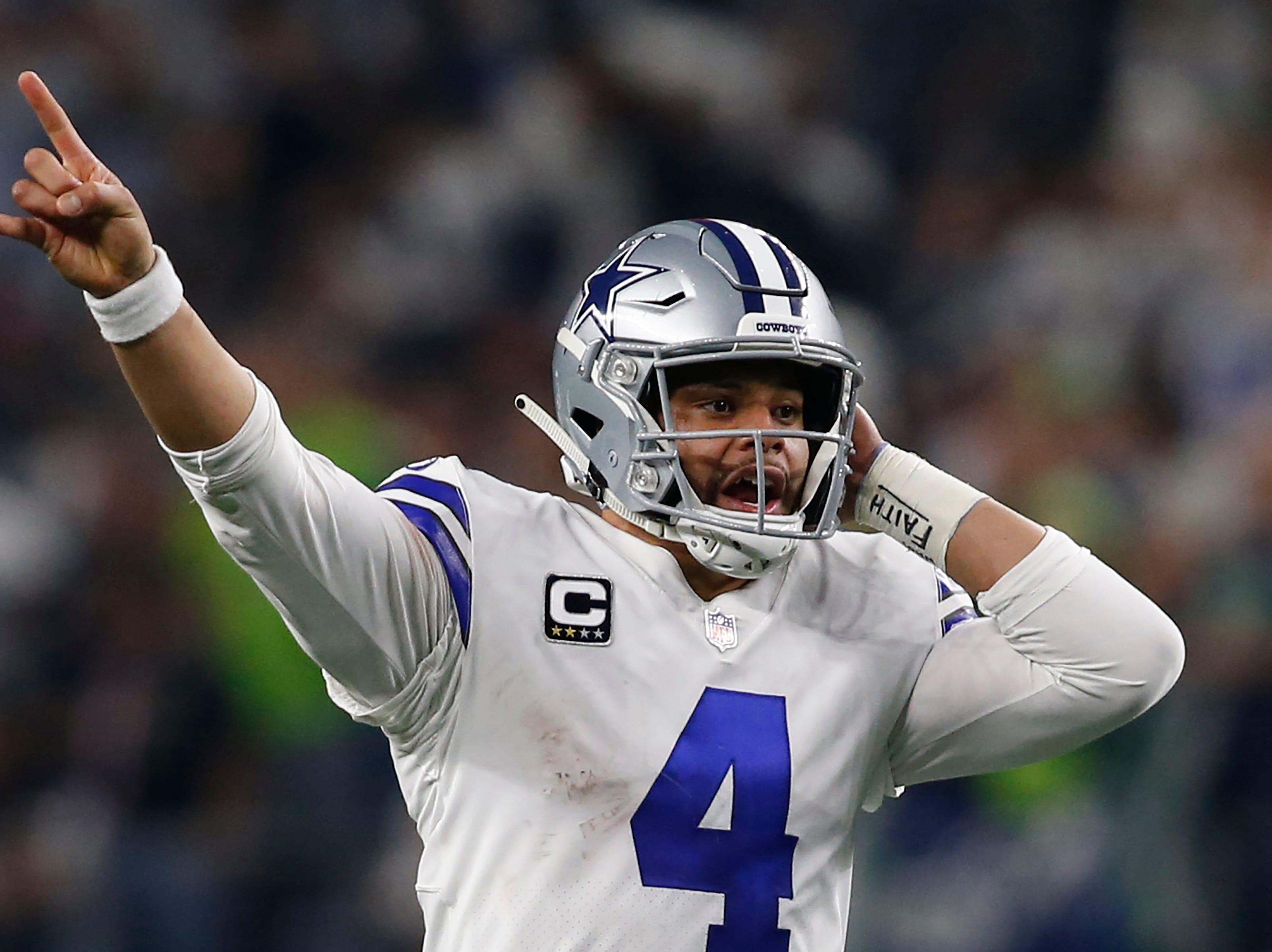 Dallas Cowboys quarterback Dak Prescott calls a play in the fourth quarter against the Seattle Seahawks at AT&T Stadium.