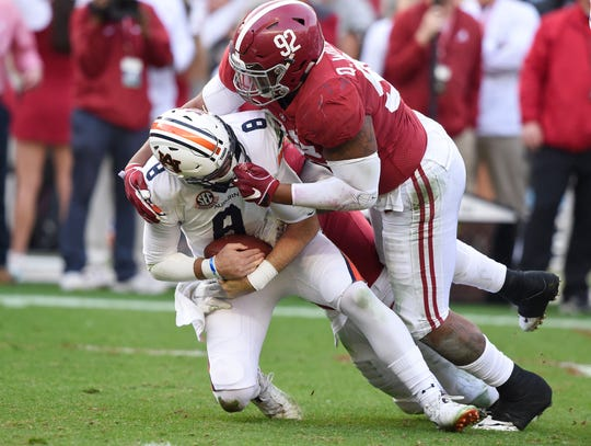 Alabama defensive lineman Quinnen Williams puts a hit on Auburn quarterback Jarrett Stidham during their game in 2018.