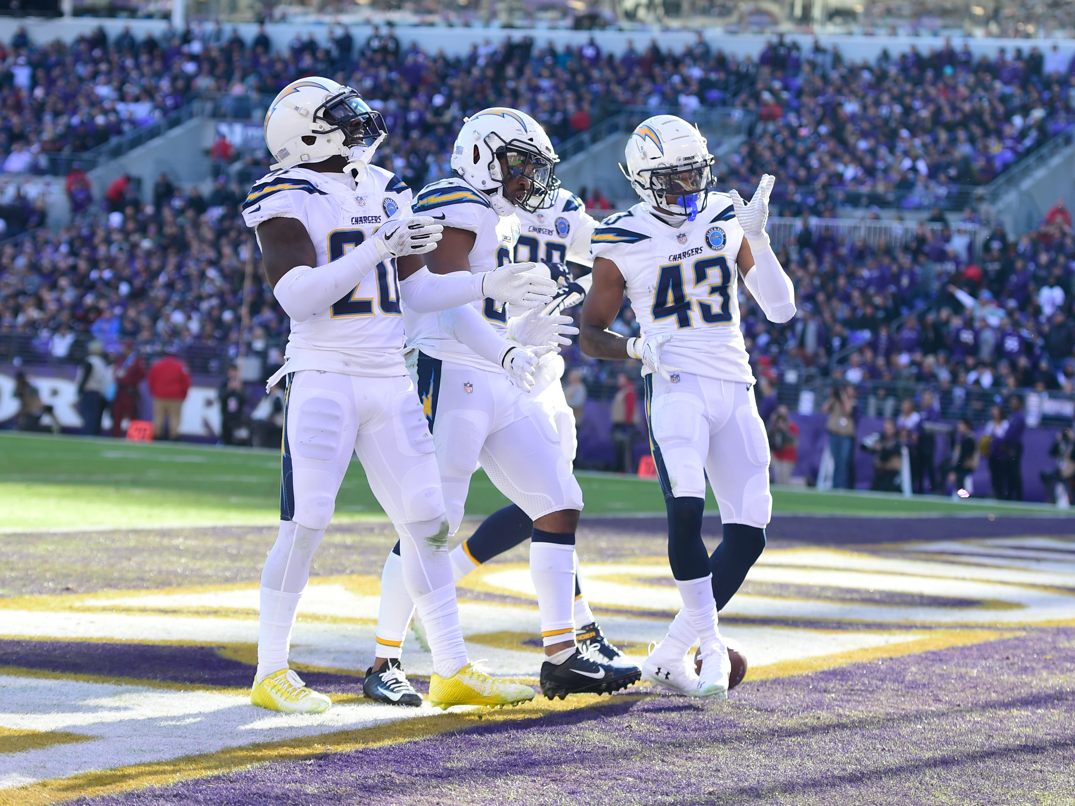 Los Angeles Chargers celebrate in the end zone after safety Adrian Phillips (31) second quarter interception against the Baltimore Ravens in a AFC Wild Card playoff football game at M&T Bank Stadium.