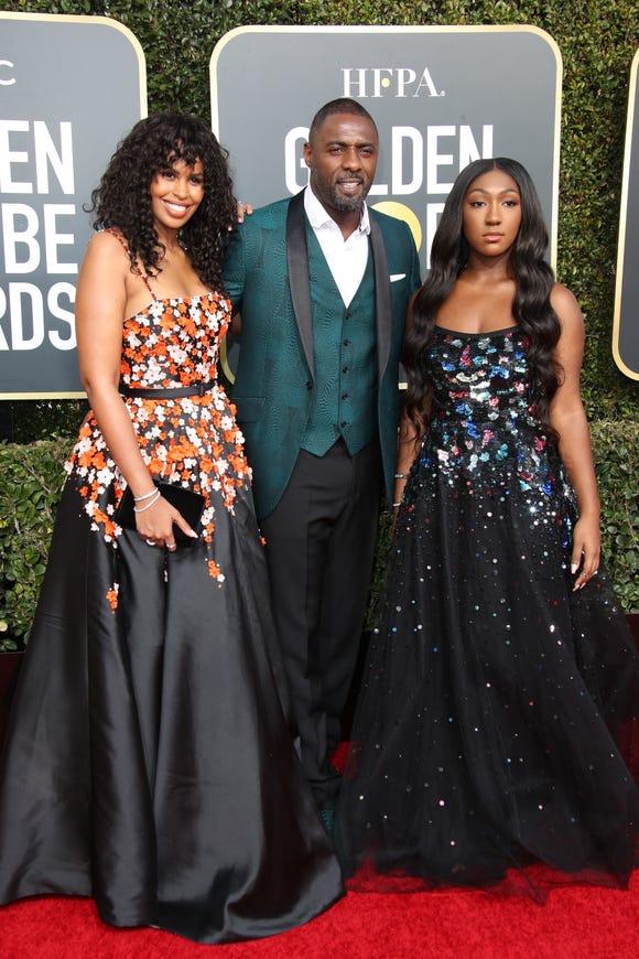 Idris Elba, center, Sabrina Dhowre, left, and Isan Elba