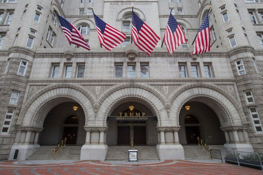 The Old Post Office Pavilion Clock Tower, which remains open during the partial government shutdown, above the Trump International Hotel, Jan. 4, 2019, in Washington.