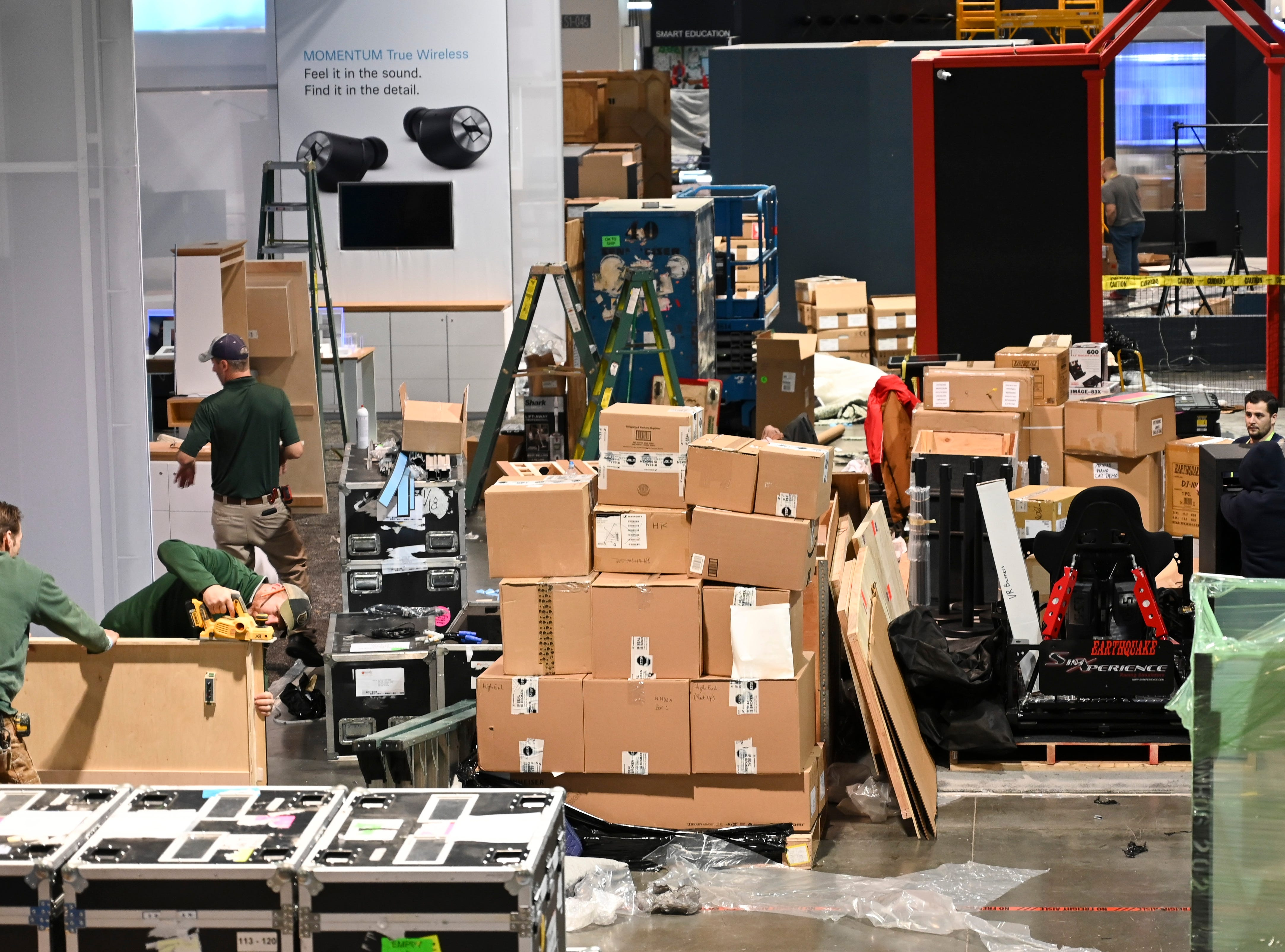 Work crews move in crates and assemble displays in the South Hall of the Las Vegas Convention Center preparing for the Consumer Electronics Show 2019