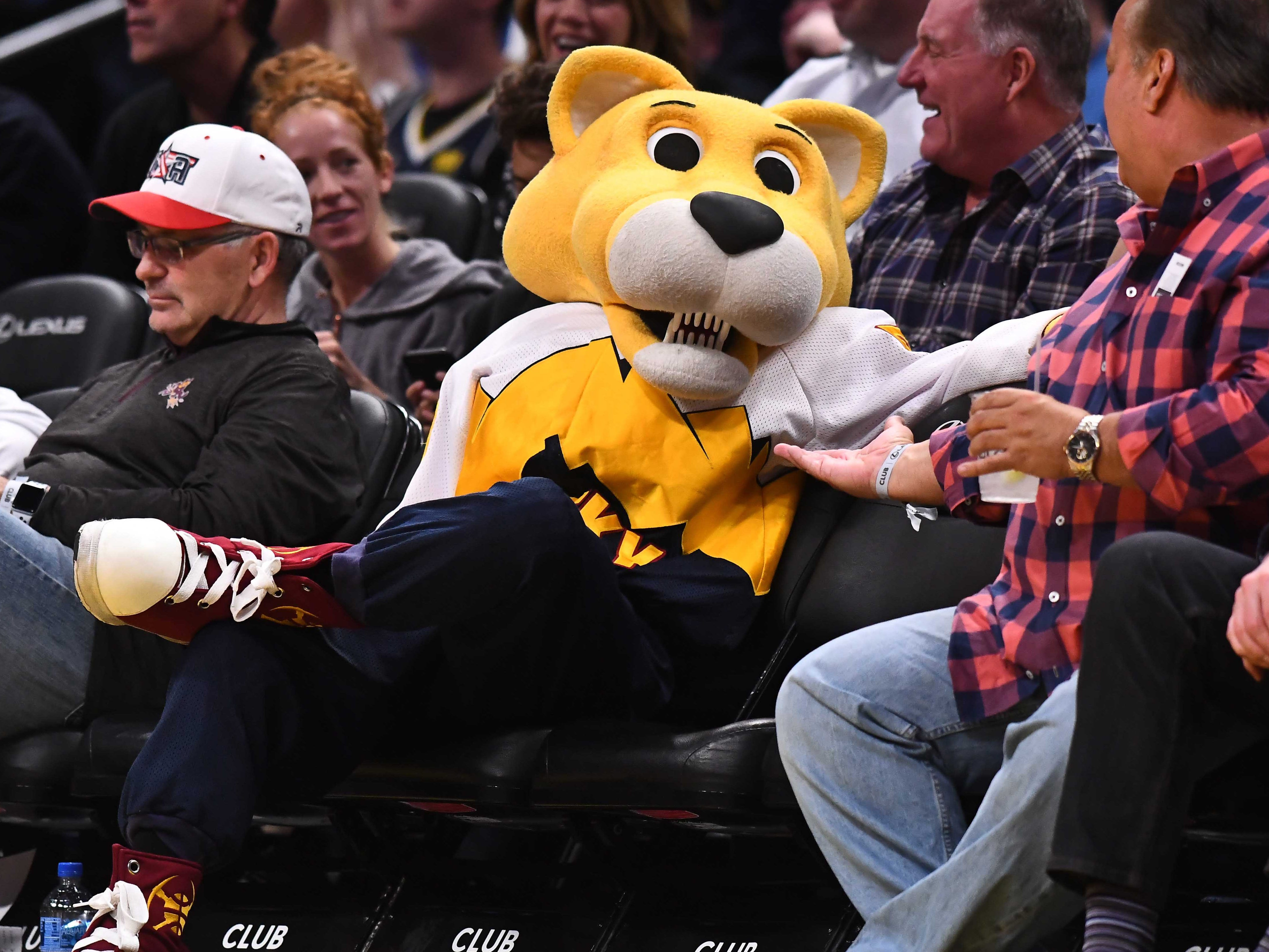 Jan. 5: Nuggets mascot Rocky takes a break in the courtside seats during the second half against the Hornets at the Pepsi Center.