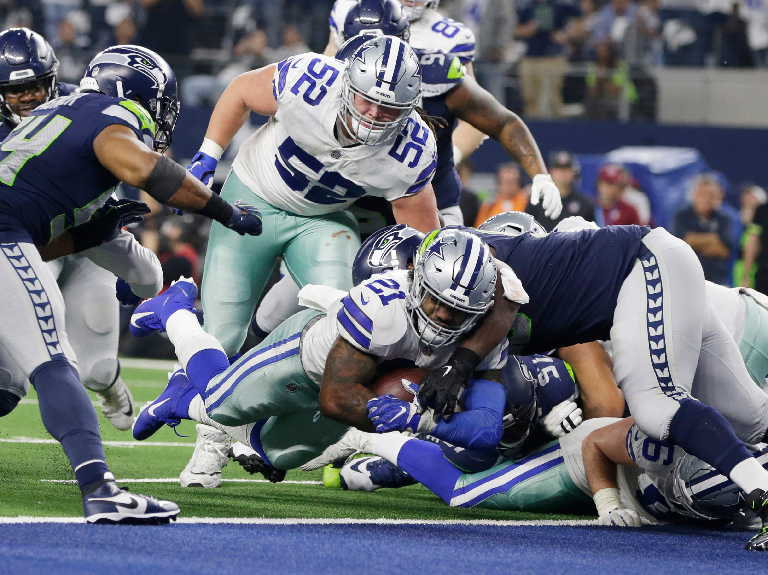 Dallas Cowboys running back Ezekiel Elliott (21) scores a touchdown in the fourth quarter against the Seattle Seahawks at AT&T Stadium.