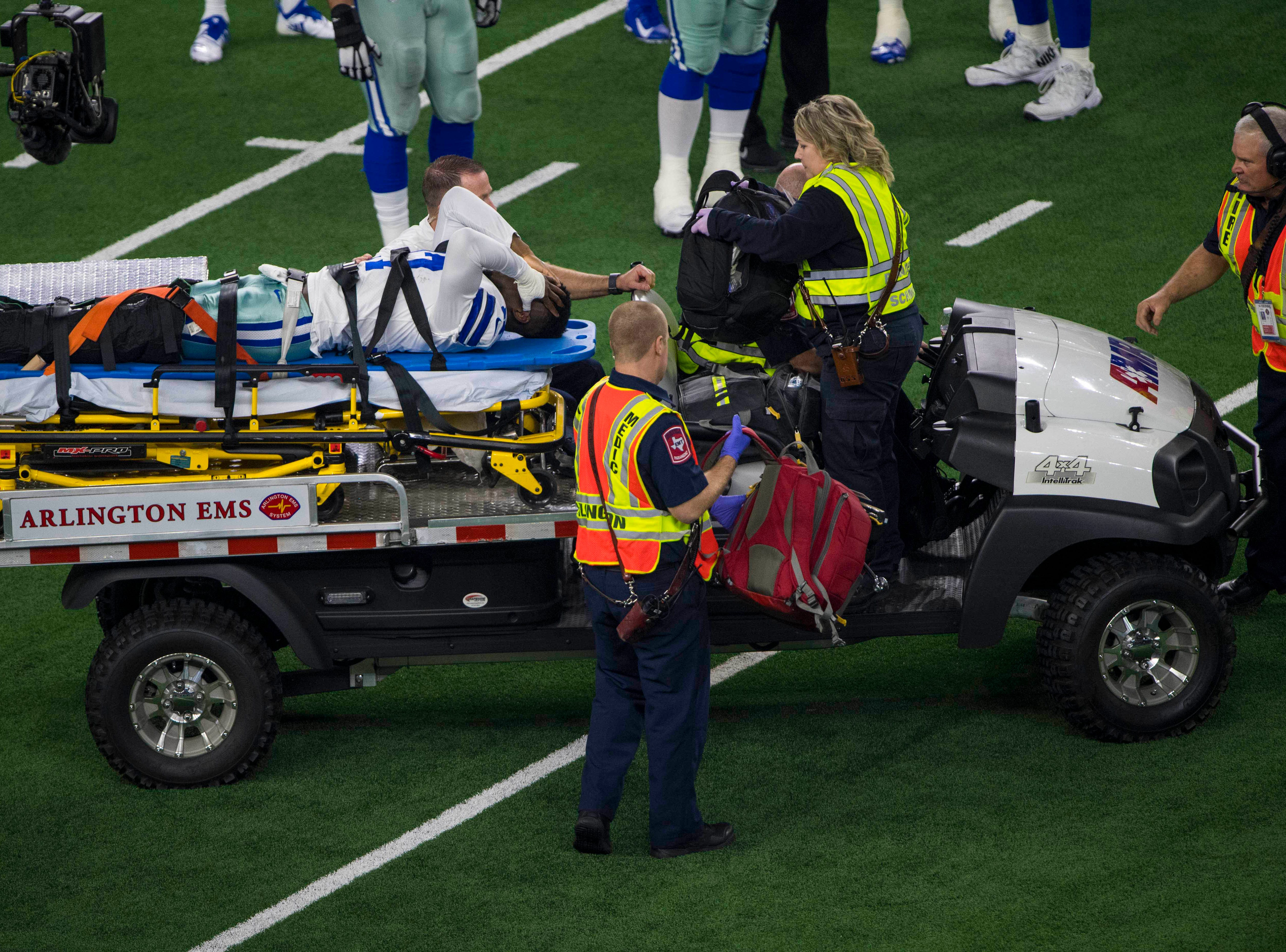 Dallas Cowboys wide receiver Allen Hurns is carted off the field during the first quarter against the Seattle Seahawks at AT&T Stadium.