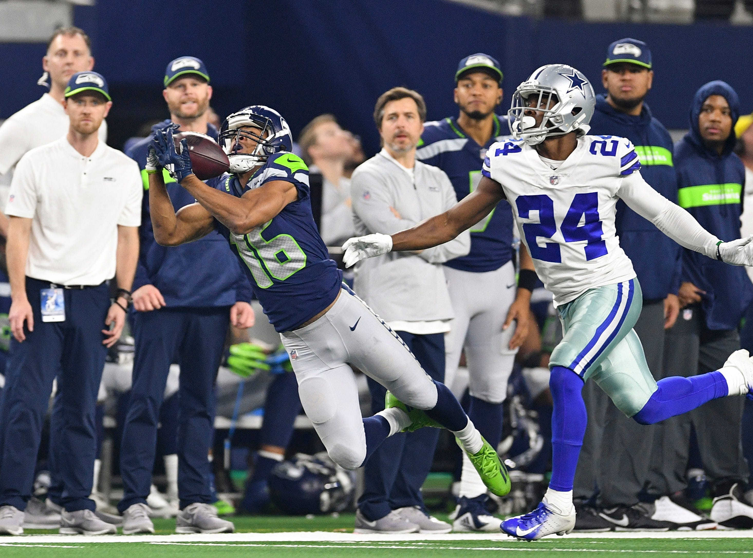 Seattle Seahawks wide receiver Tyler Lockett (16) catches a pass against the Dallas Cowboys in the second quarter at AT&T Stadium.