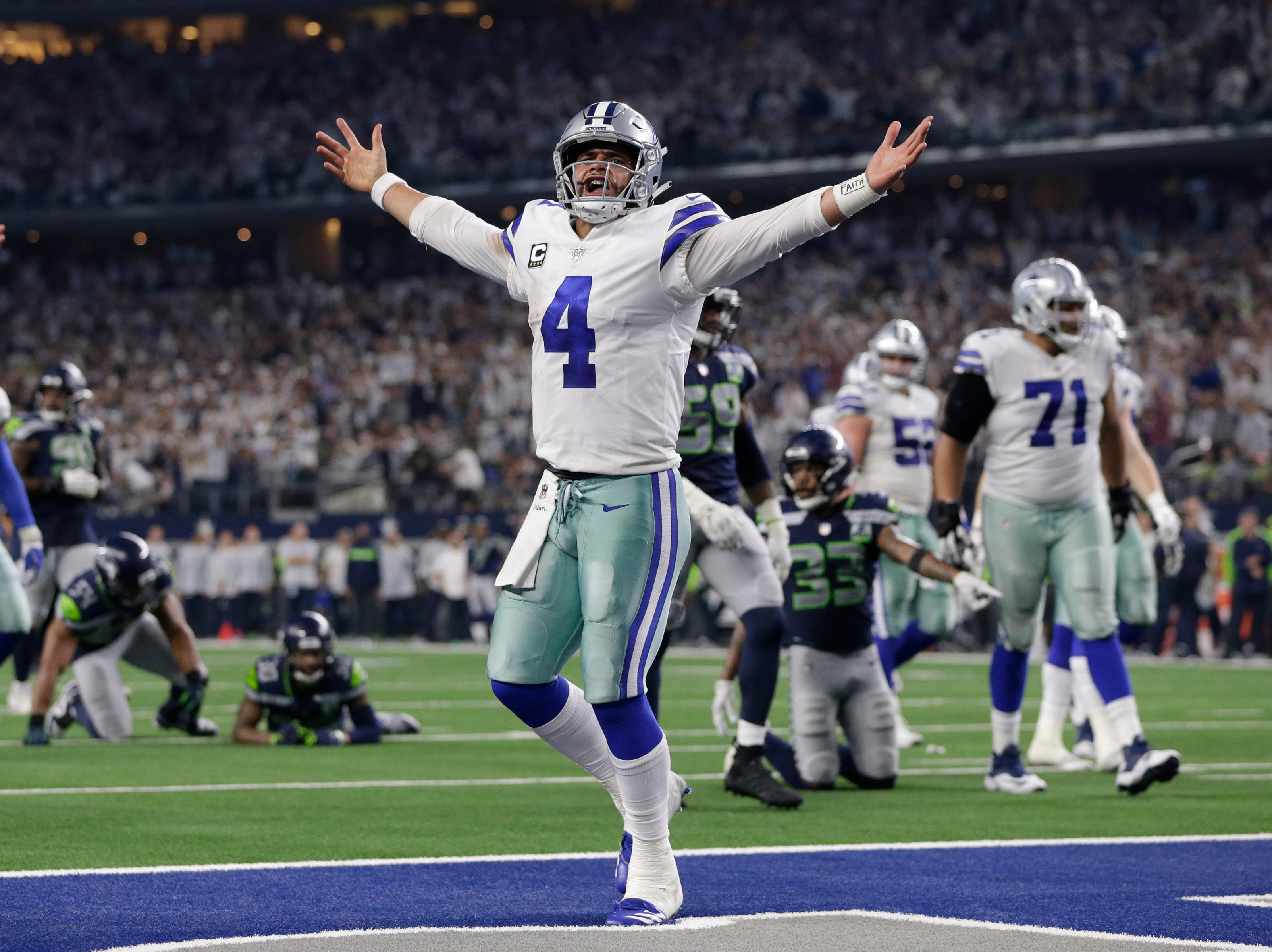Dallas Cowboys quarterback Dak Prescott (4) reacts to running down to the 1-yard line in the fourth quarter at AT&T Stadium.