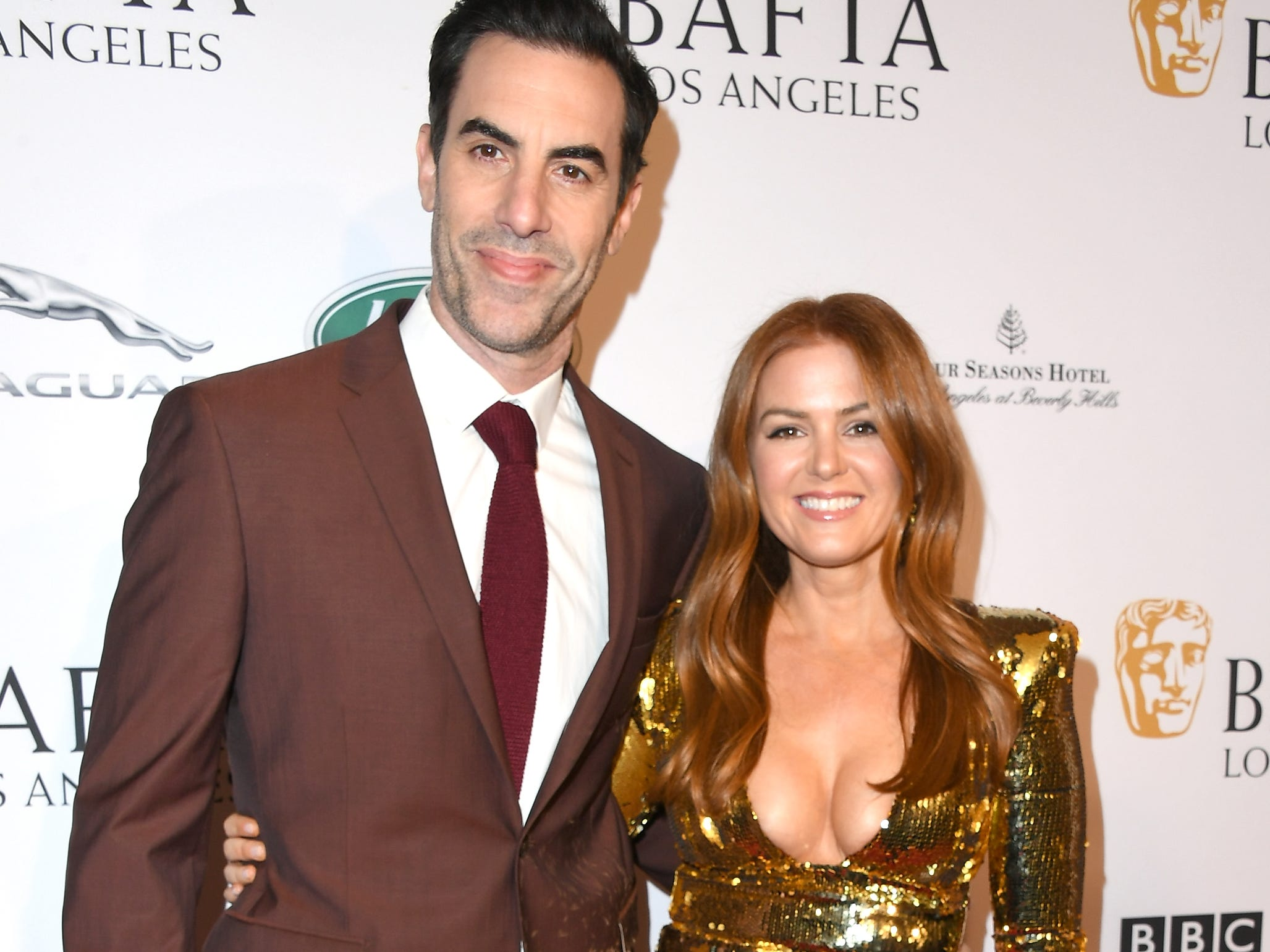 LOS ANGELES, CA - JANUARY 05:  Sacha Baron Cohen (L) and Isla Fisher attend The BAFTA Los Angeles Tea Party at Four Seasons Hotel Los Angeles at Beverly Hills on January 5, 2019 in Los Angeles, California.  (Photo by Jon Kopaloff/Getty Images) ORG XMIT: 775261683 ORIG FILE ID: 1077926658