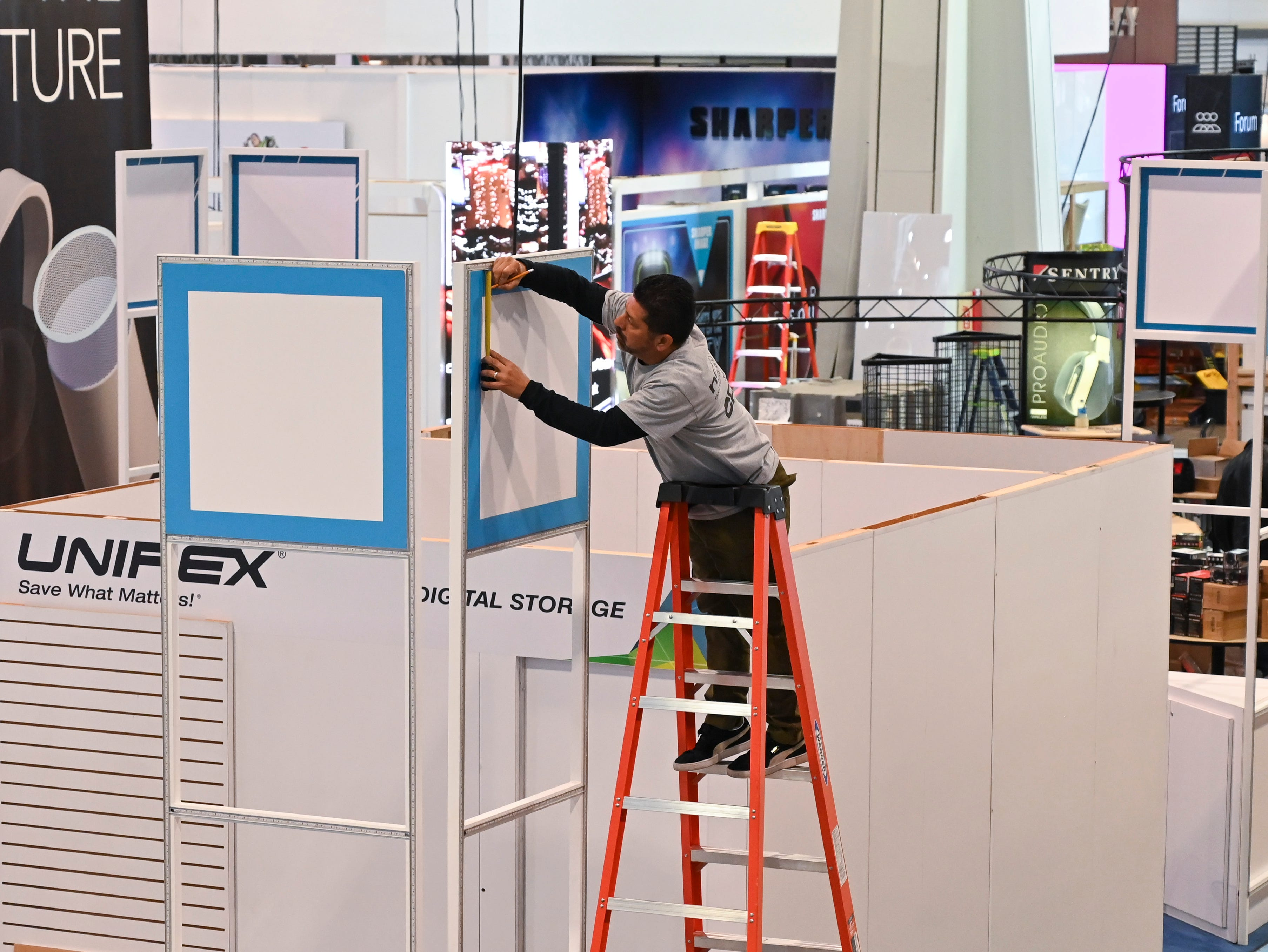 A worker readies a booth in the Central Hall of the Las Vegas Convention Center. The Consumer Electronics Show 2019.