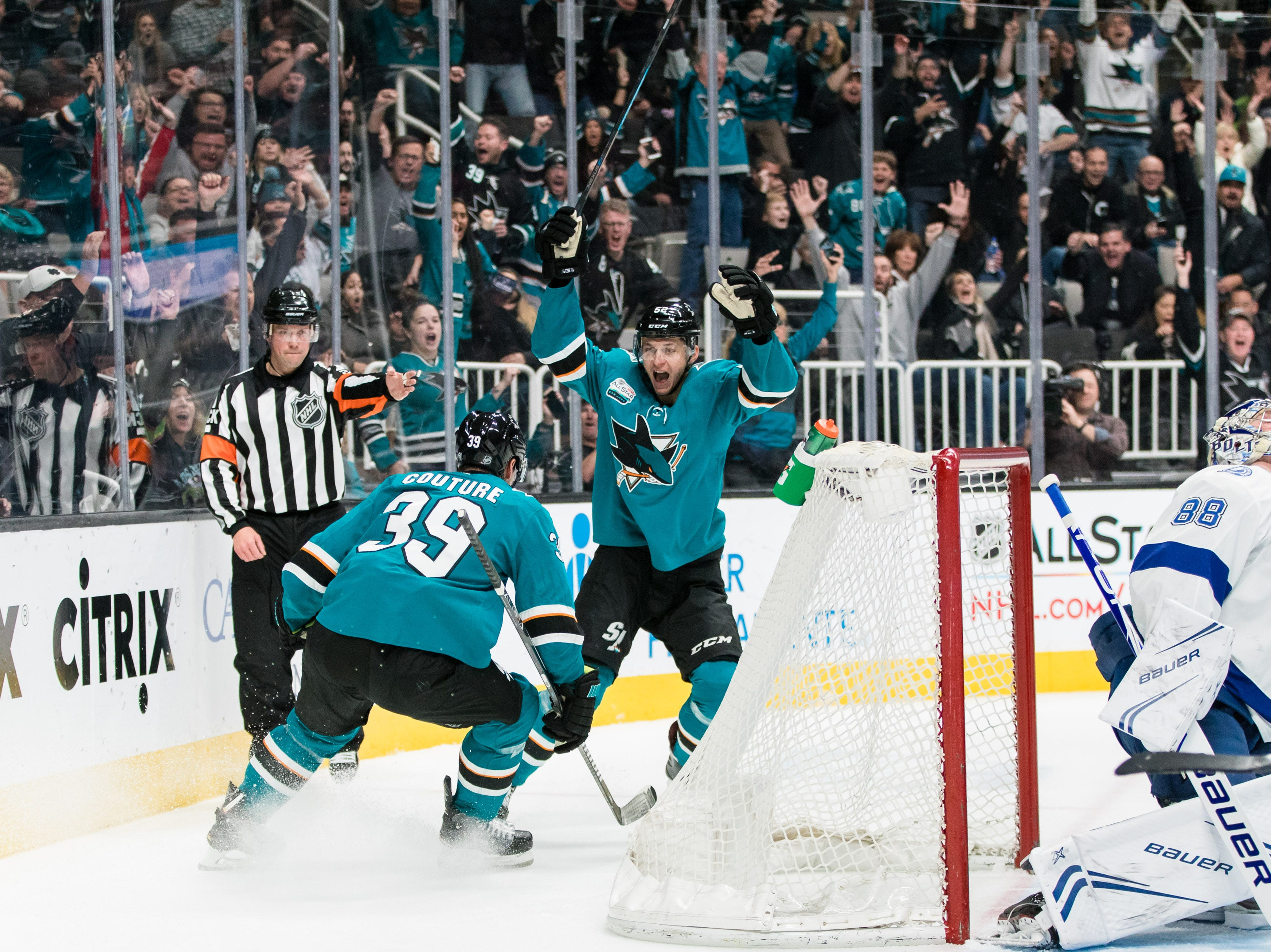 Jan. 5: San Jose Sharks forwards Logan Couture (39) and Lukas Radil (52) celebrate after scoring a goal against the Tampa Bay Lightning in the first period at SAP Center.