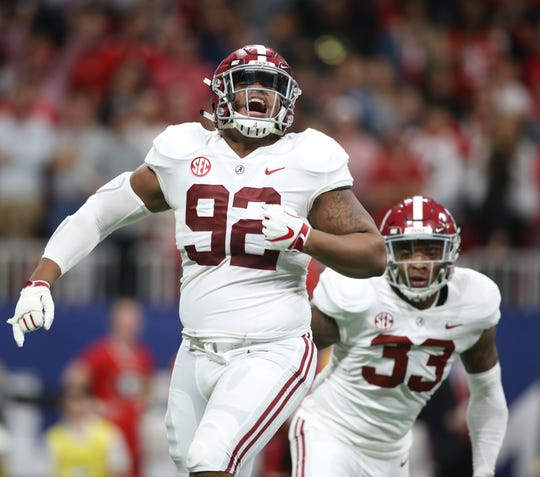 Alabama defensive lineman Quinnen Williams celebrates after a sack against Georgia in the SEC championship game.