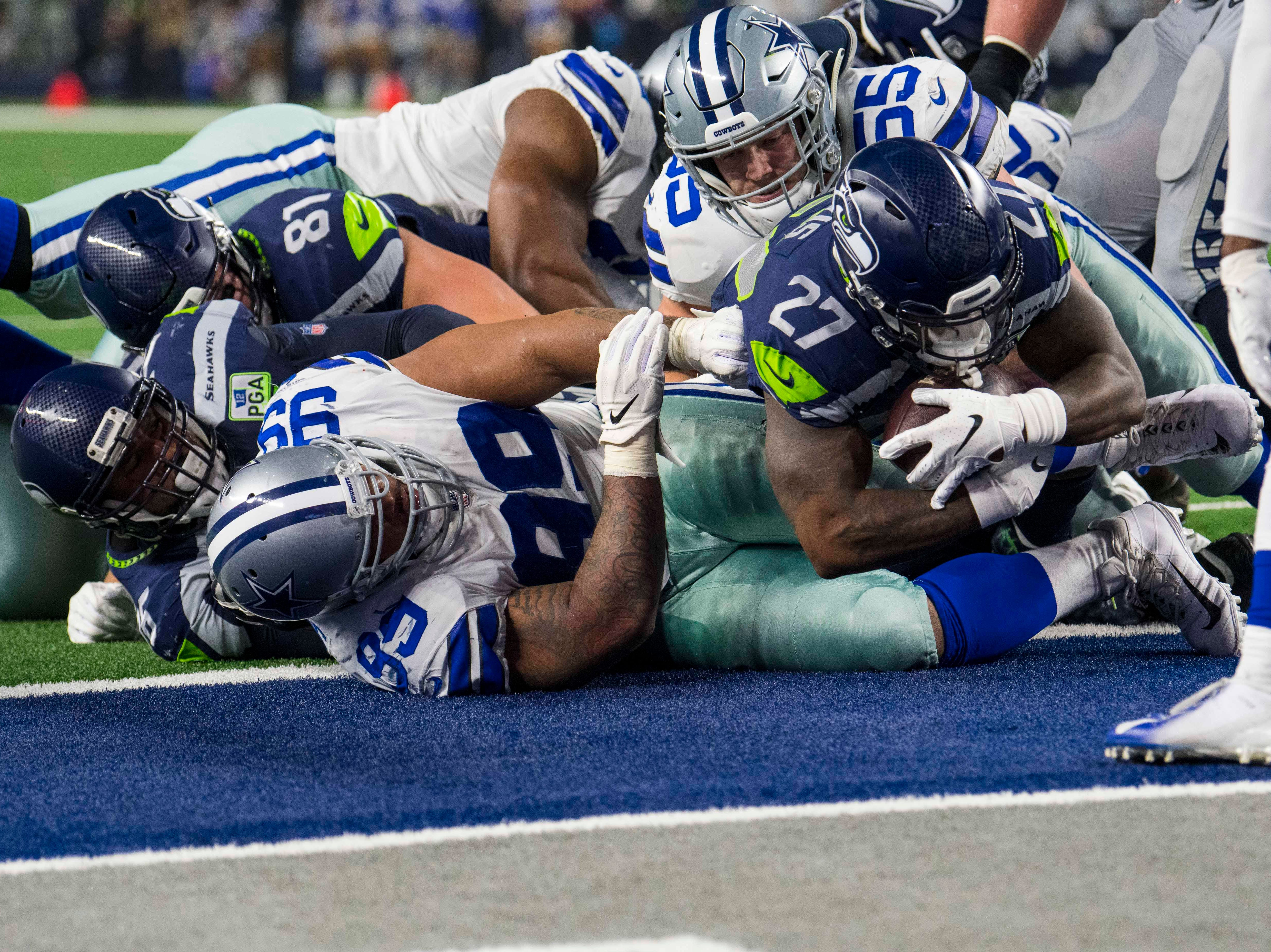 Seattle Seahawks running back Mike Davis (27) scores on a two point conversion run against the Dallas Cowboys during the third quarter at AT&T Stadium.