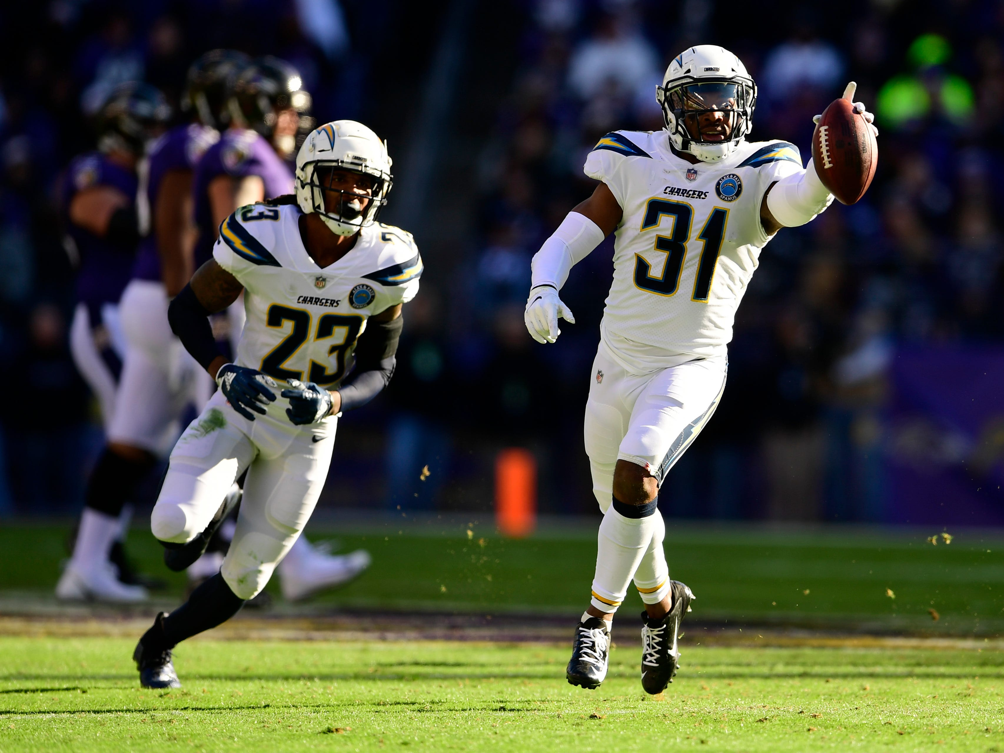 Los Angeles Chargers safety Adrian Phillips (31) reacts after intercepting Baltimore Ravens quarterback Lamar Jackson (not pic tired) during the second quarter in a AFC Wild Card playoff football game at M&T Bank Stadium.