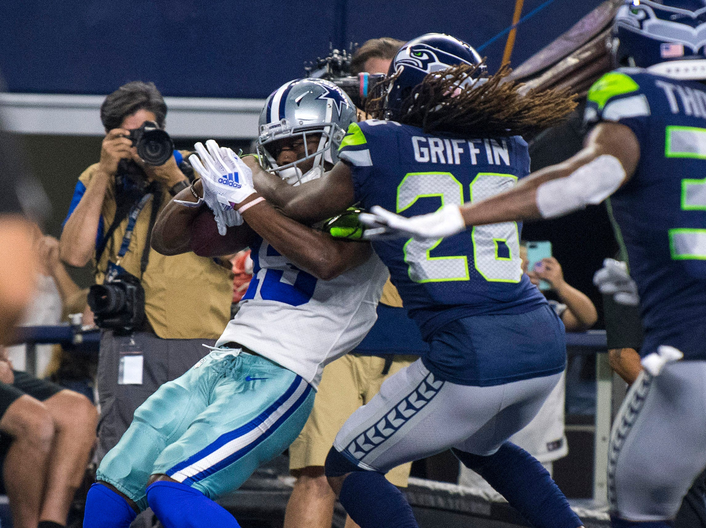 Dallas Cowboys wide receiver Michael Gallup (13) catches a pass for a touchdown against the Seattle Seahawks during the second quarter at AT&T Stadium.