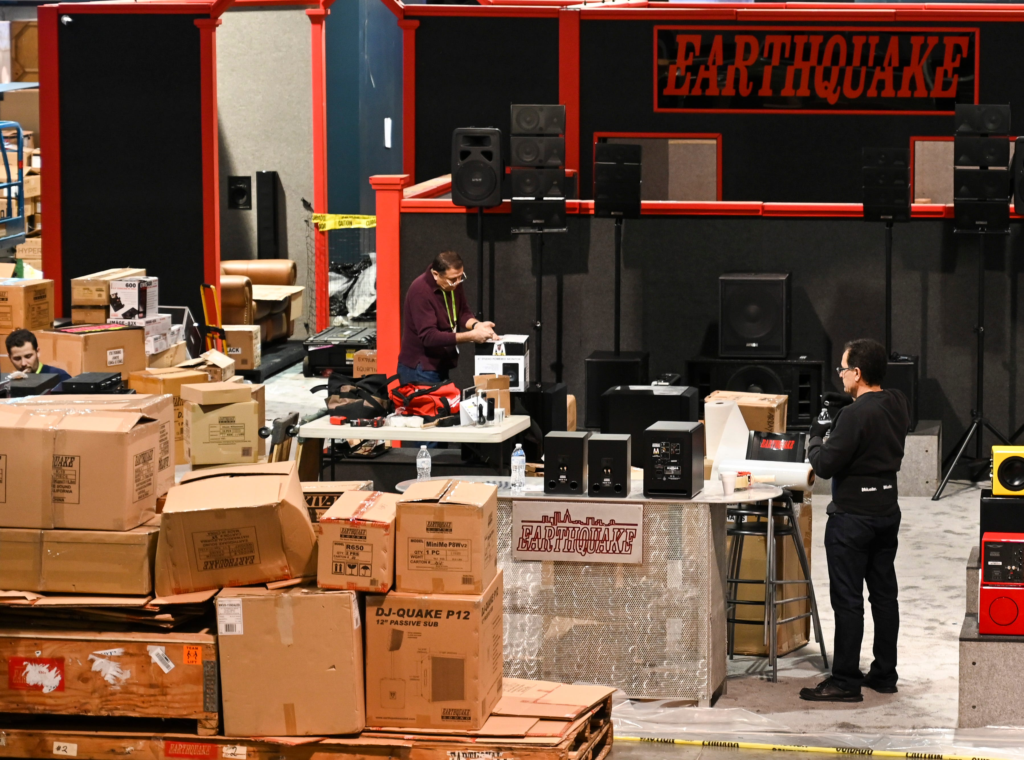 Pallets and crates stacked up in the Las Vegas Convention Center Central Hall as workers put together displays.