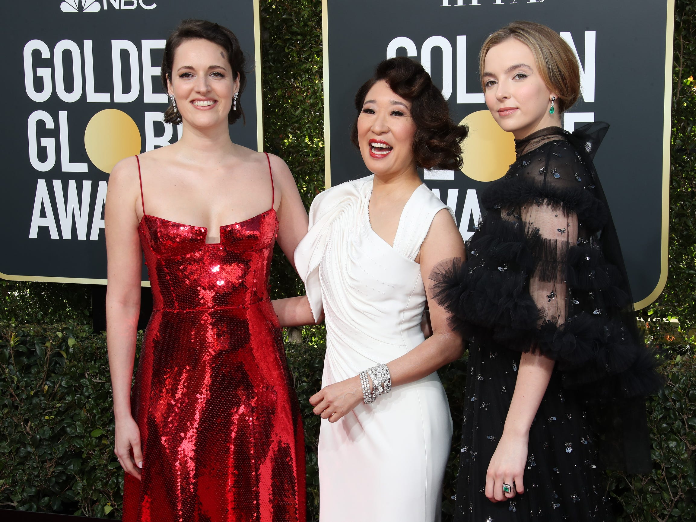 Phoebe Waller-Bridge, left, Sandra Oh, and Jodie Comer arrive.