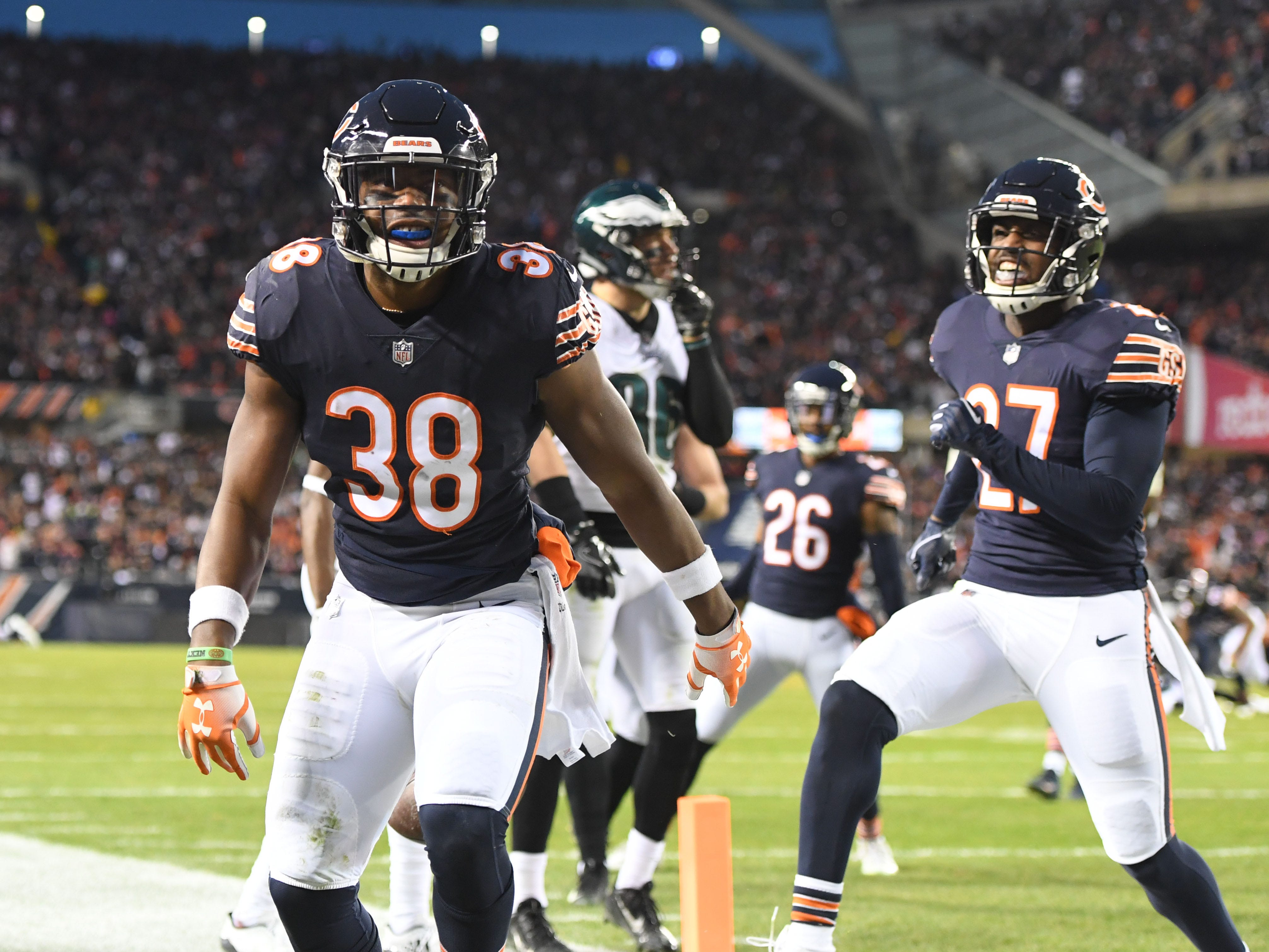 Chicago Bears strong safety Adrian Amos (38) celebrates with defensive back Sherrick McManis (27) after an interception against the Philadelphia Eagles in the first half of a NFC Wild Card playoff football game at Soldier Field.