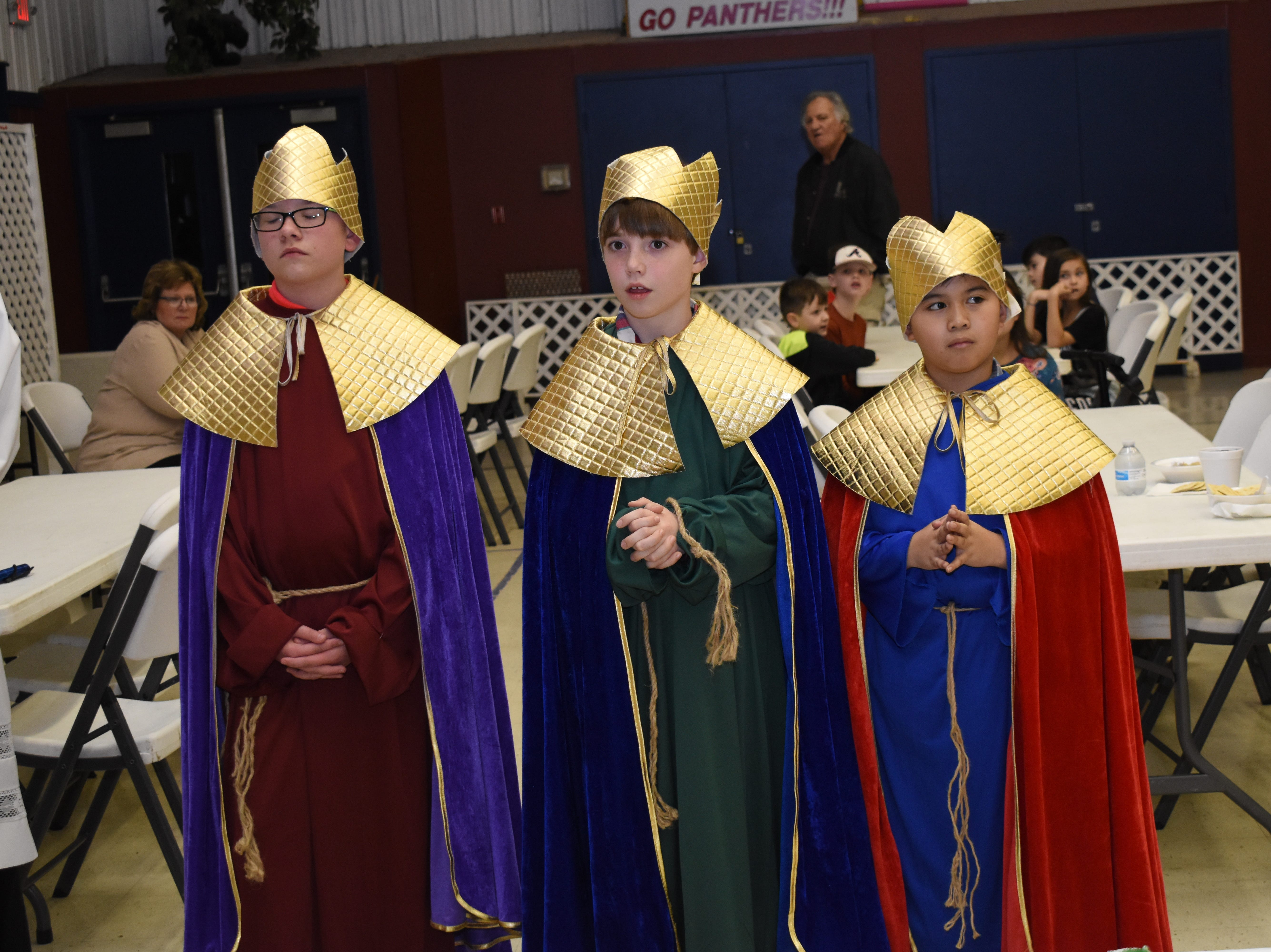 "St. Frances Cabrini Church celebrated the Epiphany, or end of the Christmas season with a mass Sunday, Jan. 6, 2019, and ushered in the Mardi Gras season. Epiphany celebrates Jesus Christ coming into the world and being visited by the Three Wise Men or Magi. Daren Kho, John Gary Hines and Eli Aymond portrayed the Three Wise Men who presented Jesus with gifts of gold, frankincense and myrrh after following the Star of Bethlehem to find him. The ""Burning of the Greens"" followed the mass. Christmas trees and wreaths were burned, symbolizing the light of Jesus coming into the world. Boy Scout Troop 6 helped light the greens on fire. A dinner of Queen's soup was served. The soup was created to honor the queen of the Mardi Gras balls. and Father Chad Partain blessed the King Cakes. King Cakes are served before Lent to celebrate the Mardi Gras season. The cakes are called King Cakes because of Three Wise Men. Local Mardi Gras Krewes were recognized during the celebration. Mardi Gras is March 5."