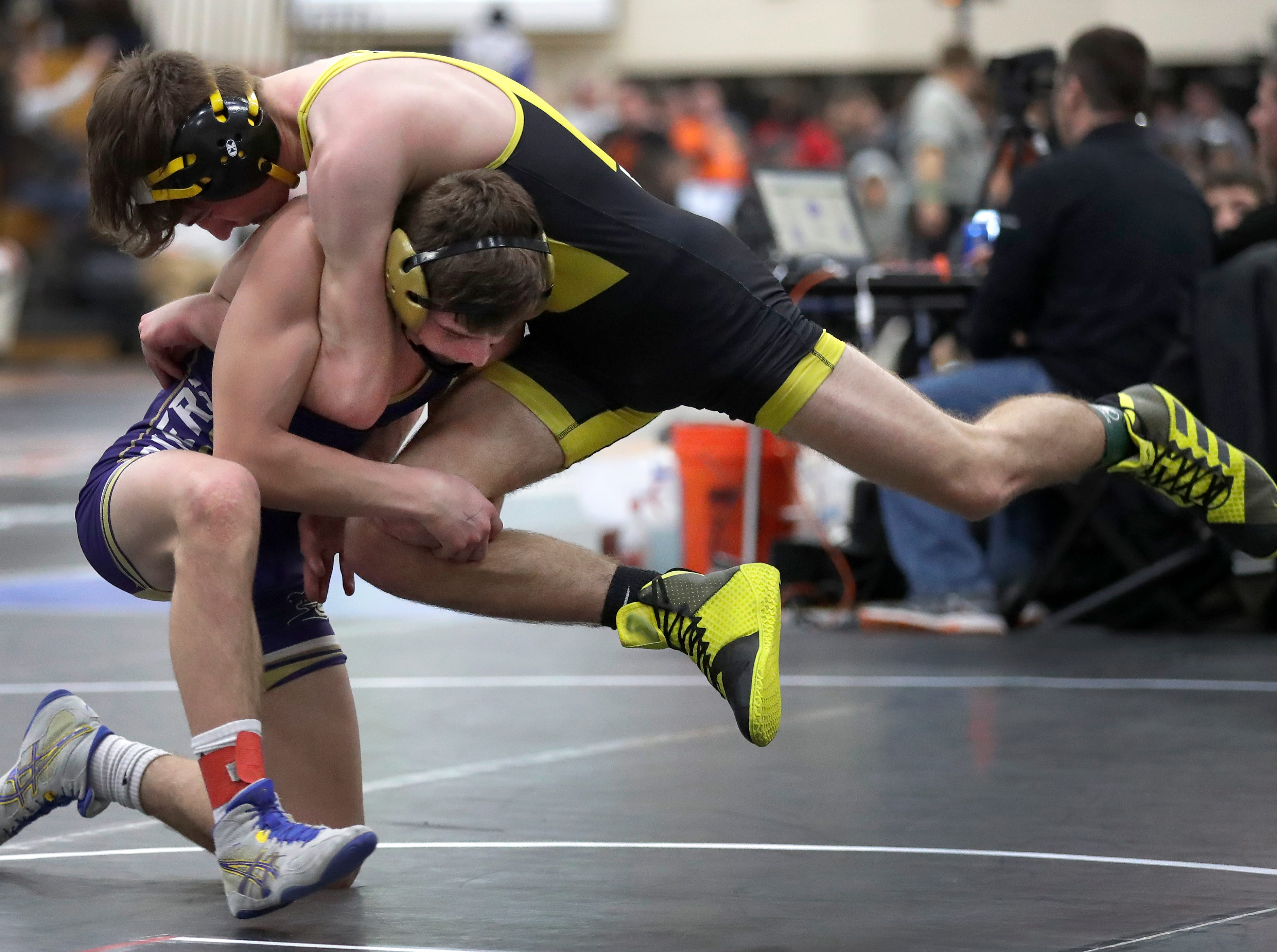 Two Rivers High School's Matty Bianchi against Matea Valley High School's  Kyle Smart at 132 pounds  during the Cheesehead Invitational wrestling tournament on Friday, January 4, 2019, in Kaukauna, Wis.Wm. Glasheen/USA TODAY NETWORK-Wisconsin.