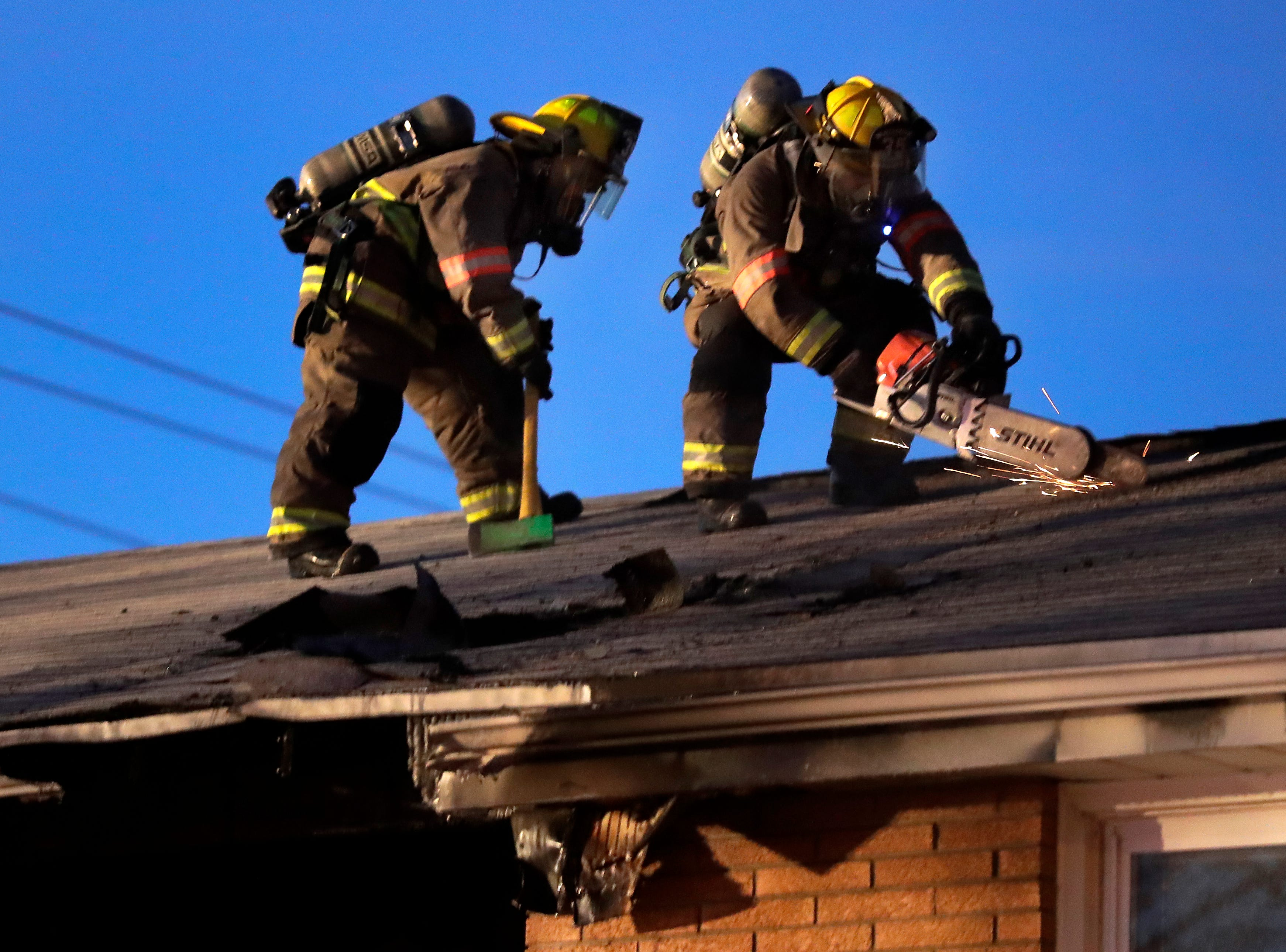 Firefighters from the Kimberly Fire Department on the scene of a second story fire in an apartment building on the1500 block of W. Fourth St. on Saturday, January 5, 2019, in Kimberly, Wis.Wm. Glasheen/USA TODAY NETWORK-Wisconsin.