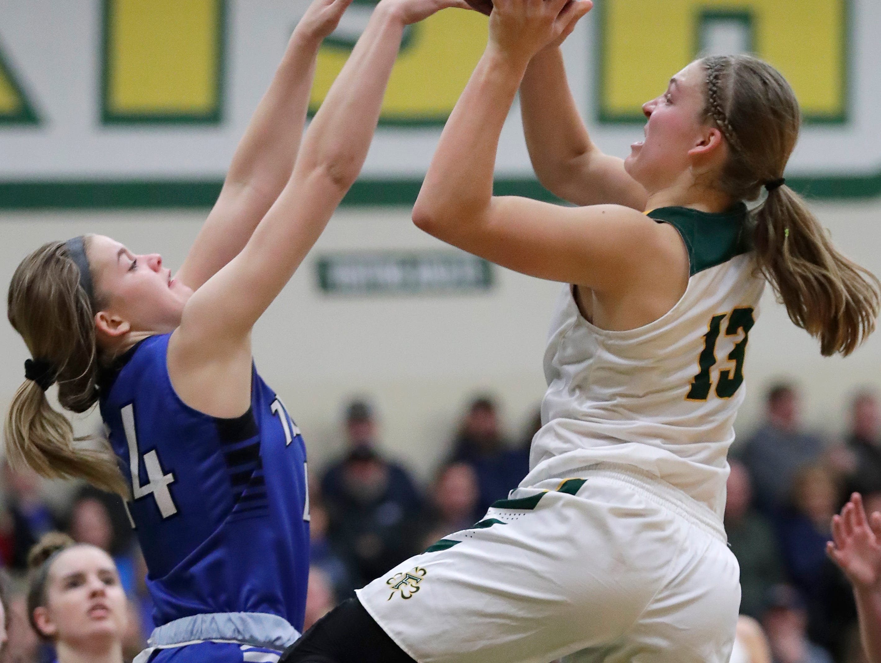 Freedom High School's #13 Gabby Johnson against Wrightstown High School's #44 Ella Diny during their North Eastern Conference girls basketball game on Thursday, January 3, 2019, in Freedom, Wis. Freedom defeated Wrightstown 54 to 34.Wm. Glasheen/USA TODAY NETWORK-Wisconsin.