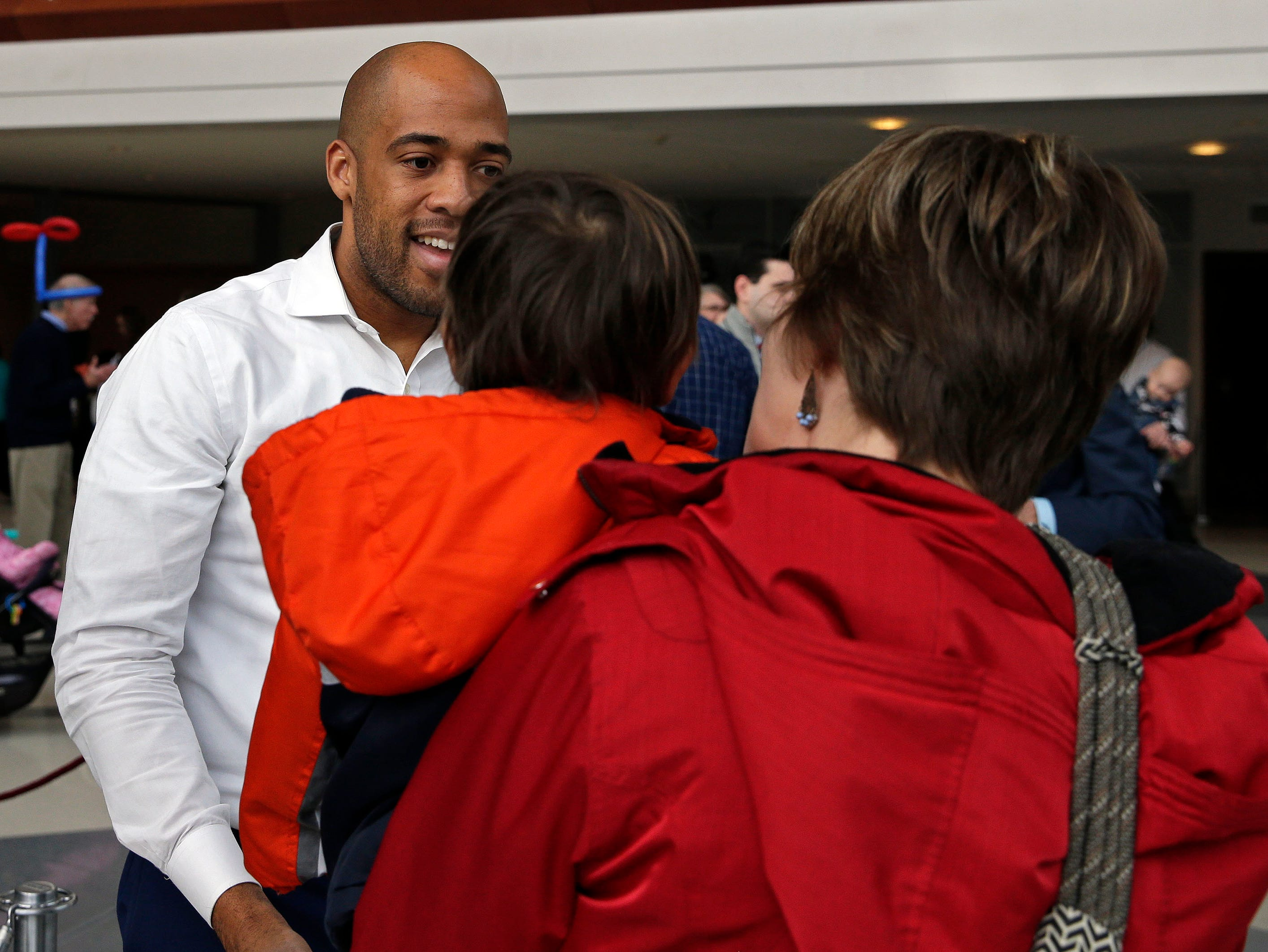 Lieutenant Governor-elect Mandela Barnes speaks with Karin and Daniel Alvarez of Appleton during the Inaugural Appleton Kids Gala Sunday, January 6, 2019, at the Fox Cities Performing Arts Center in Appleton, Wis. Barnes and Governor-elect Tony Evers spoke then posed for photos. The gala was one of three over the weekend. Events were held in Madison and Milwaukee on Saturday.Ron Page/USA TODAY NETWORK-Wisconsin