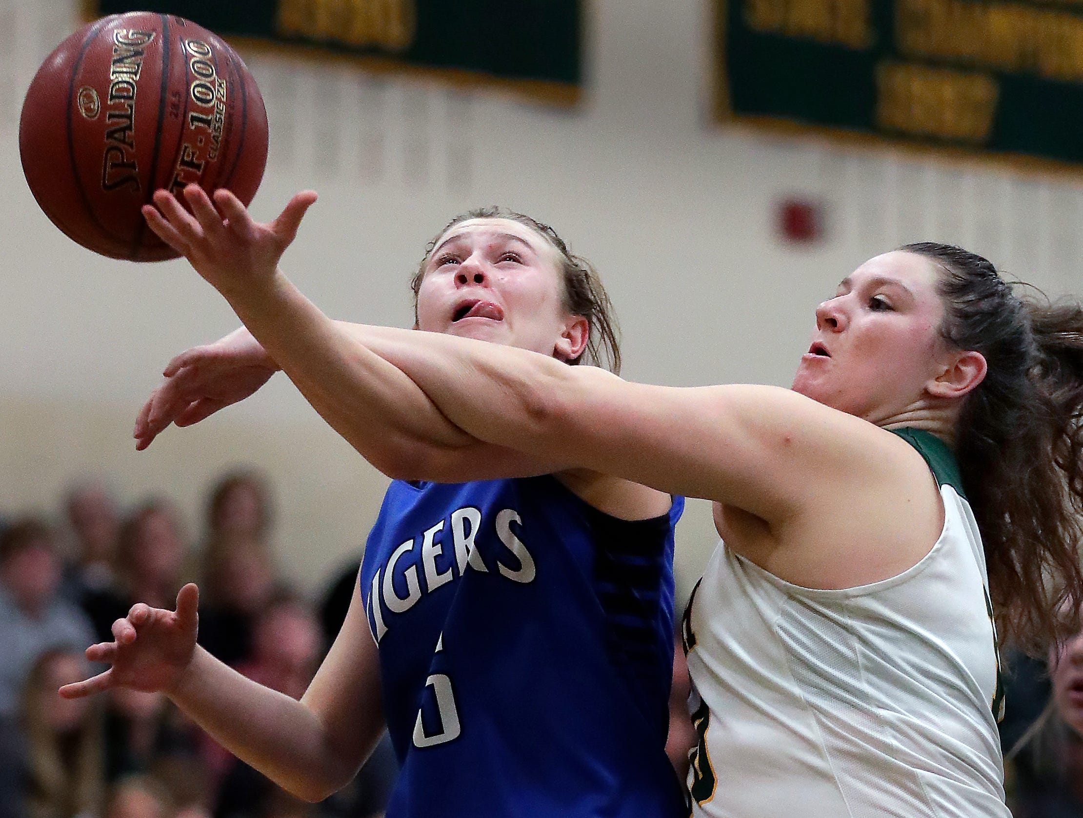 Wrightstown High School's #5 Leah Lemke against Freedom High School's #10 Cameron Evers during their North Eastern Conference girls basketball game on Thursday, January 3, 2019, in Freedom, Wis. Freedom defeated Wrightstown 54 to 34.Wm. Glasheen/USA TODAY NETWORK-Wisconsin.