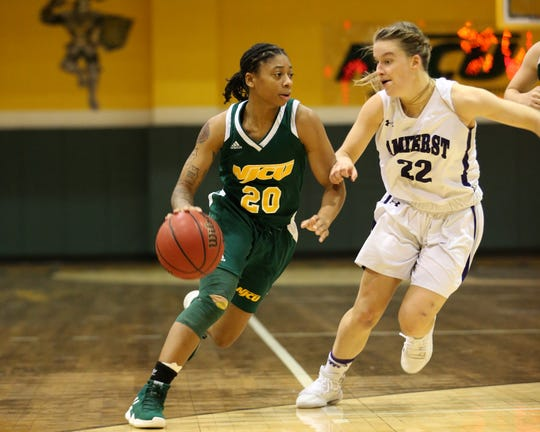 Marajiah Bacon (left) handles for NJCU women's basketball.