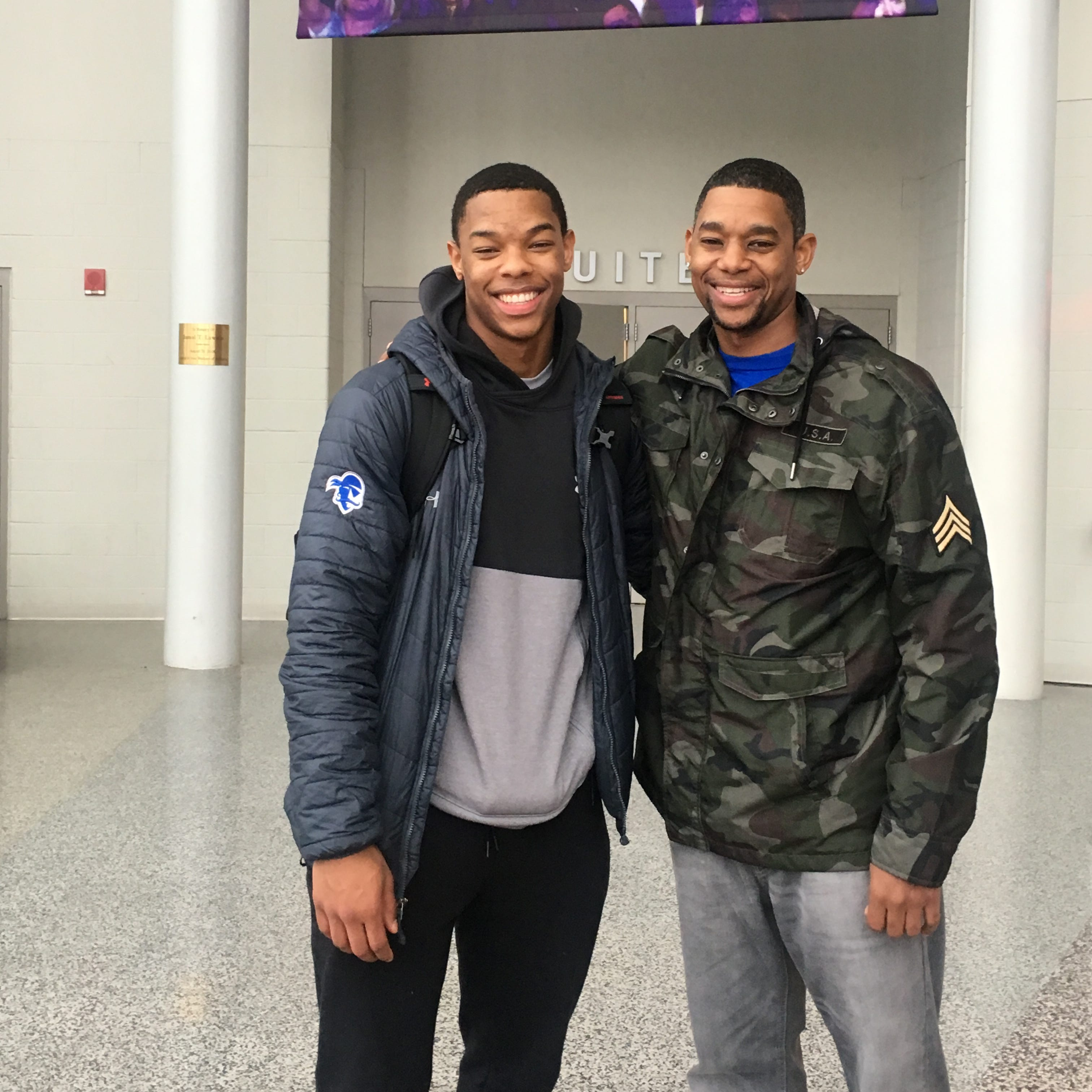 Shavar Reynolds Jr (left) with dad Shavar Reynolds Sr. (right) at the Prudential Center.