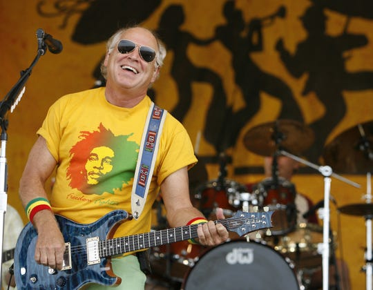Jimmy Buffett performs during the 2006 New Orleans Jazz and Heritage Festival in New Orleans on Saturday, May 6, 2006.