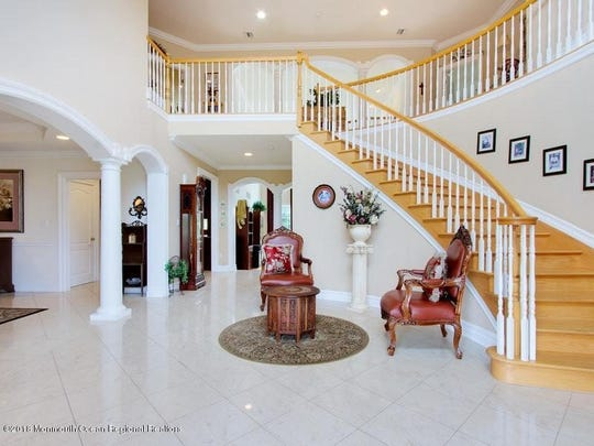The house features an open floor plan with a two-story grand entry foyer.