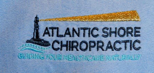 A logo on Dr. Ken Tobey's shirt at Atlantic Shore Chiropractic in Spring Lake Monday, January 7, 2019.