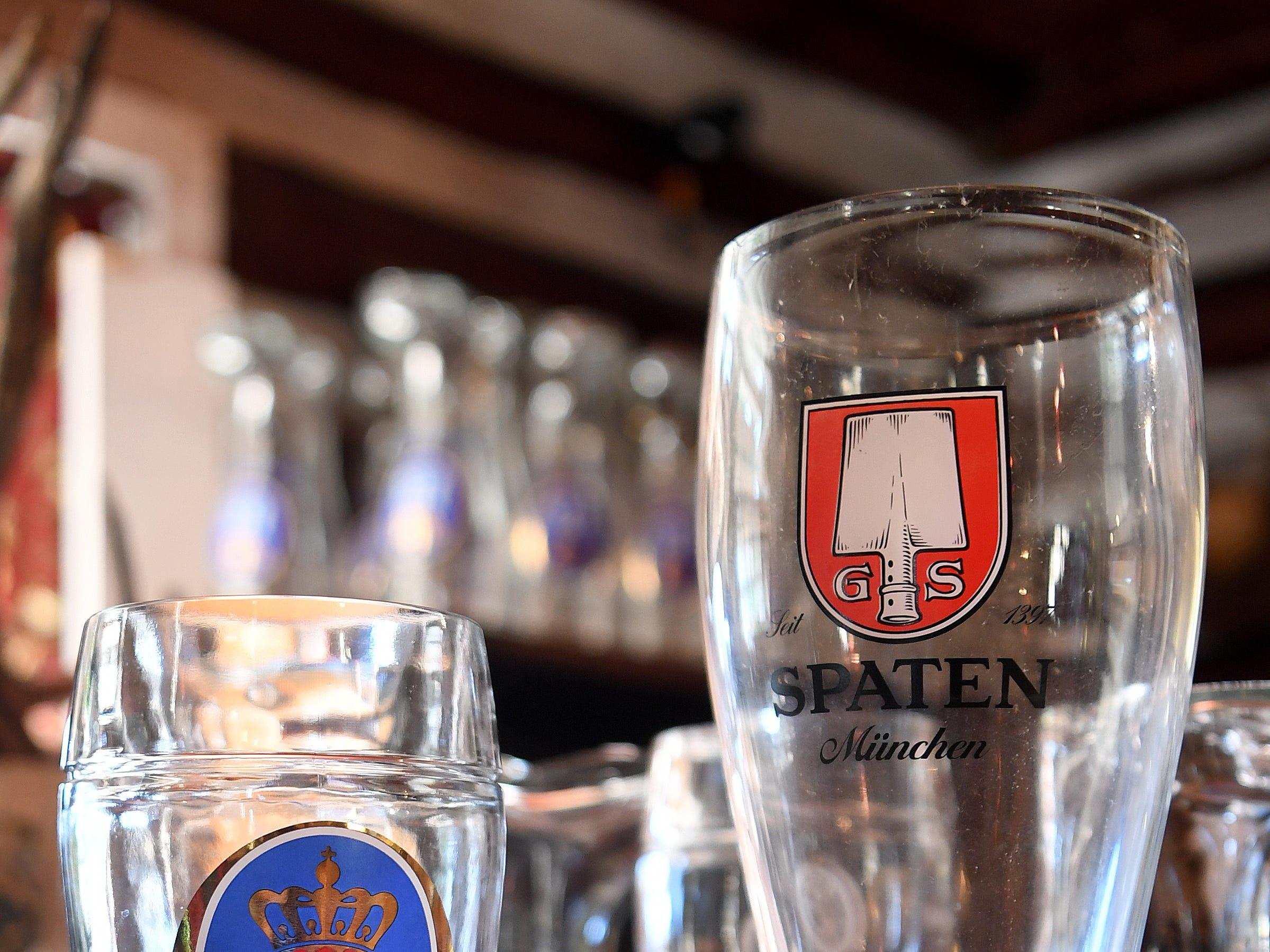 Boot glasses for beer sit on the bar at the Bavarian Restaurant & Biergarten.