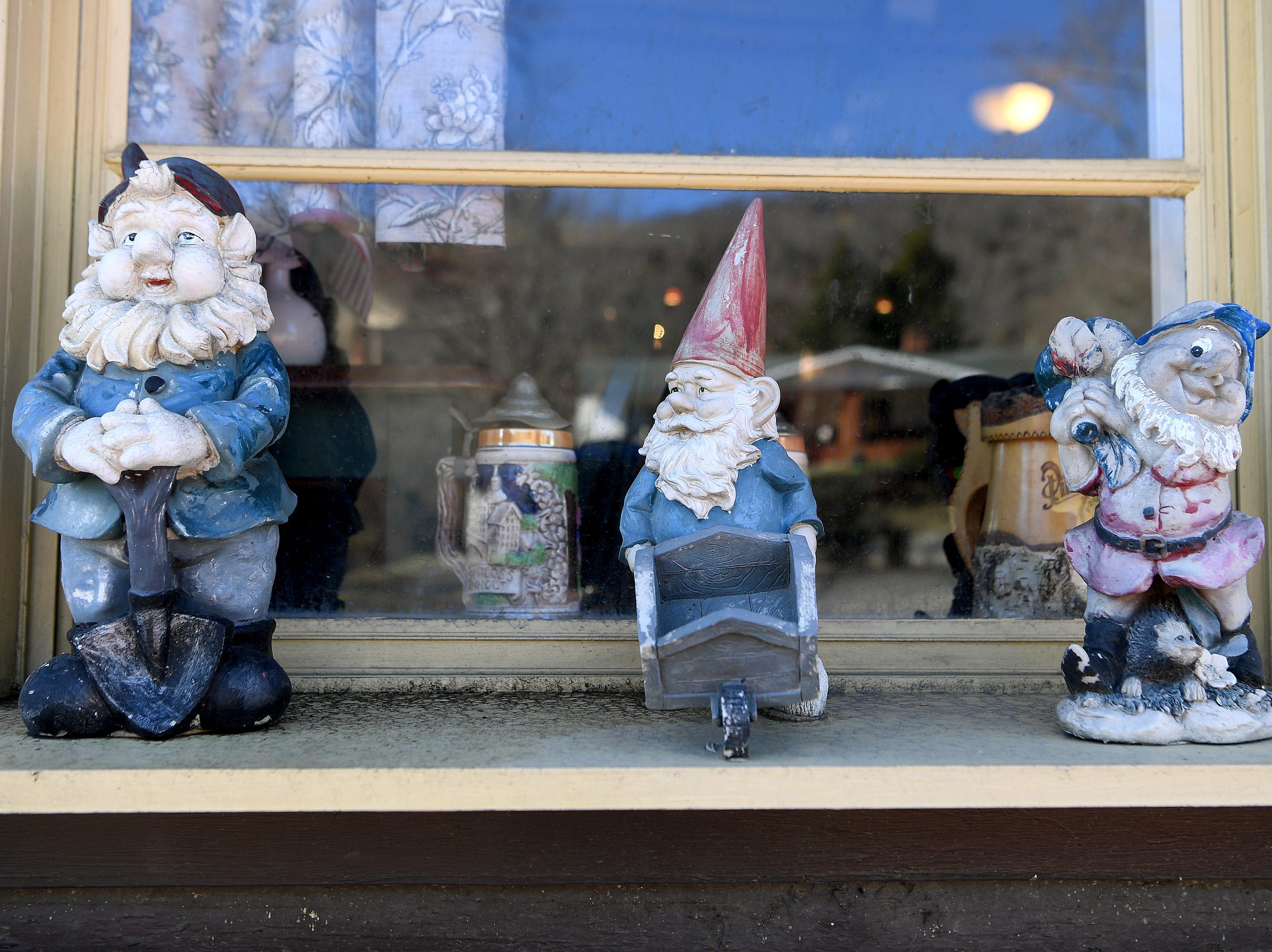 Gnomes sit on a window ledge outside of the Bavarian Restaurant & Biergarten.