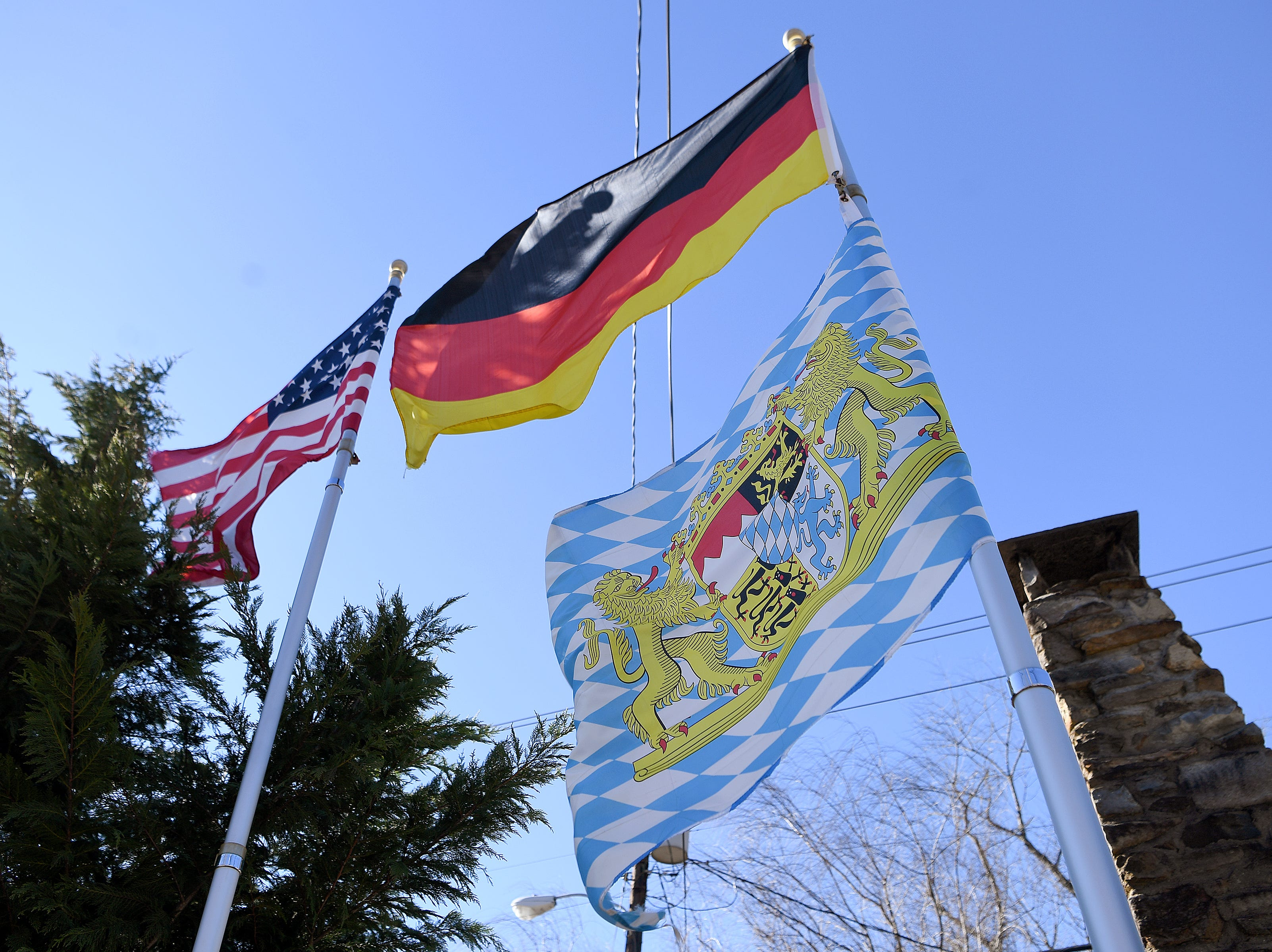 Flag fly outside of the Bavarian Restaurant & Biergarten.